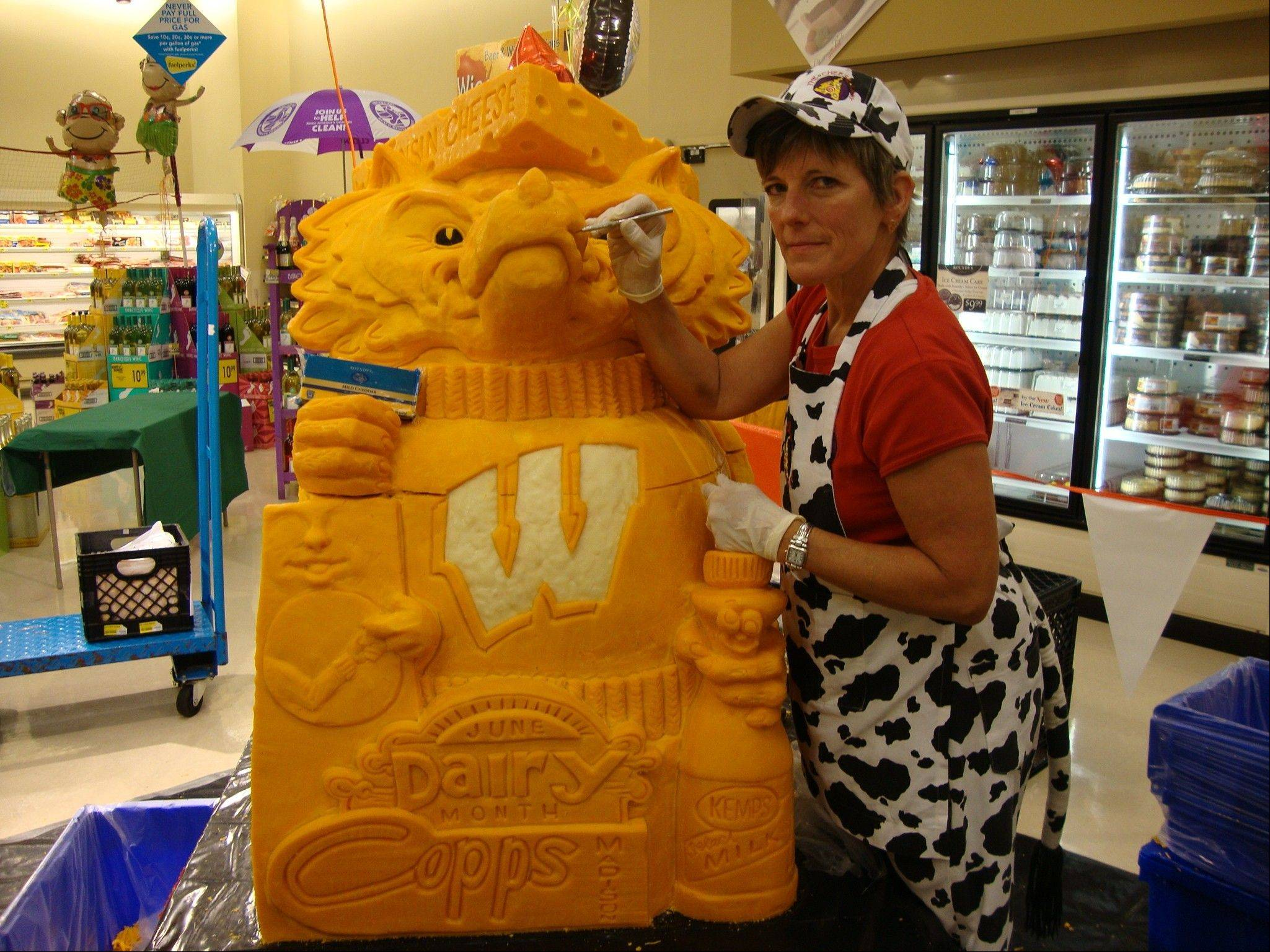 Illinois and Northwestern fans who feel Wisconsin's Bucky Badger mascot is a bit cheesy can thank cheese sculptor Sarah Kaufmann for this masterpiece in cheddar.