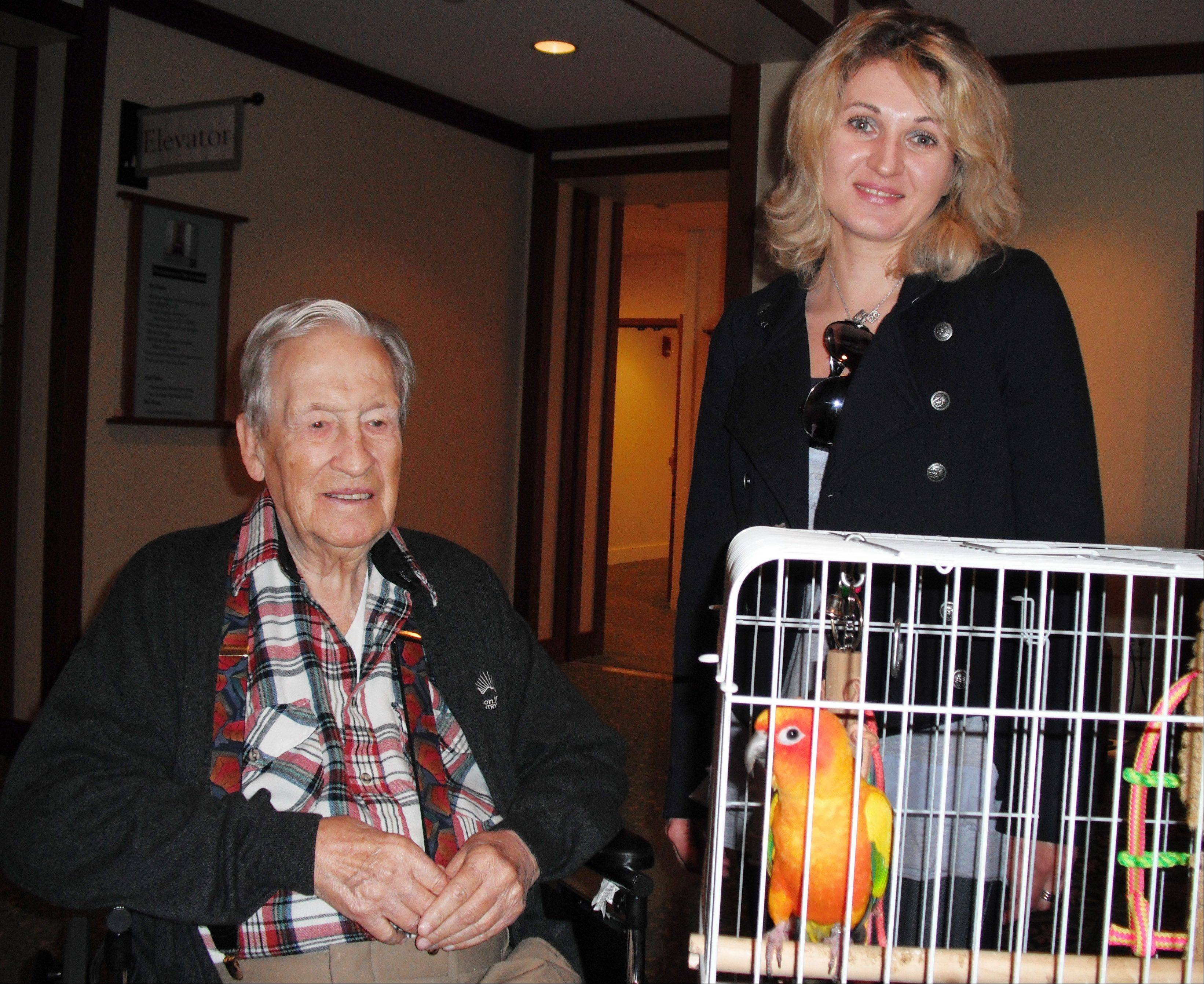 "Bird ""hero"" Ralph Ostrom with his new friend, Kasha, and its owner, Lida Dobina."