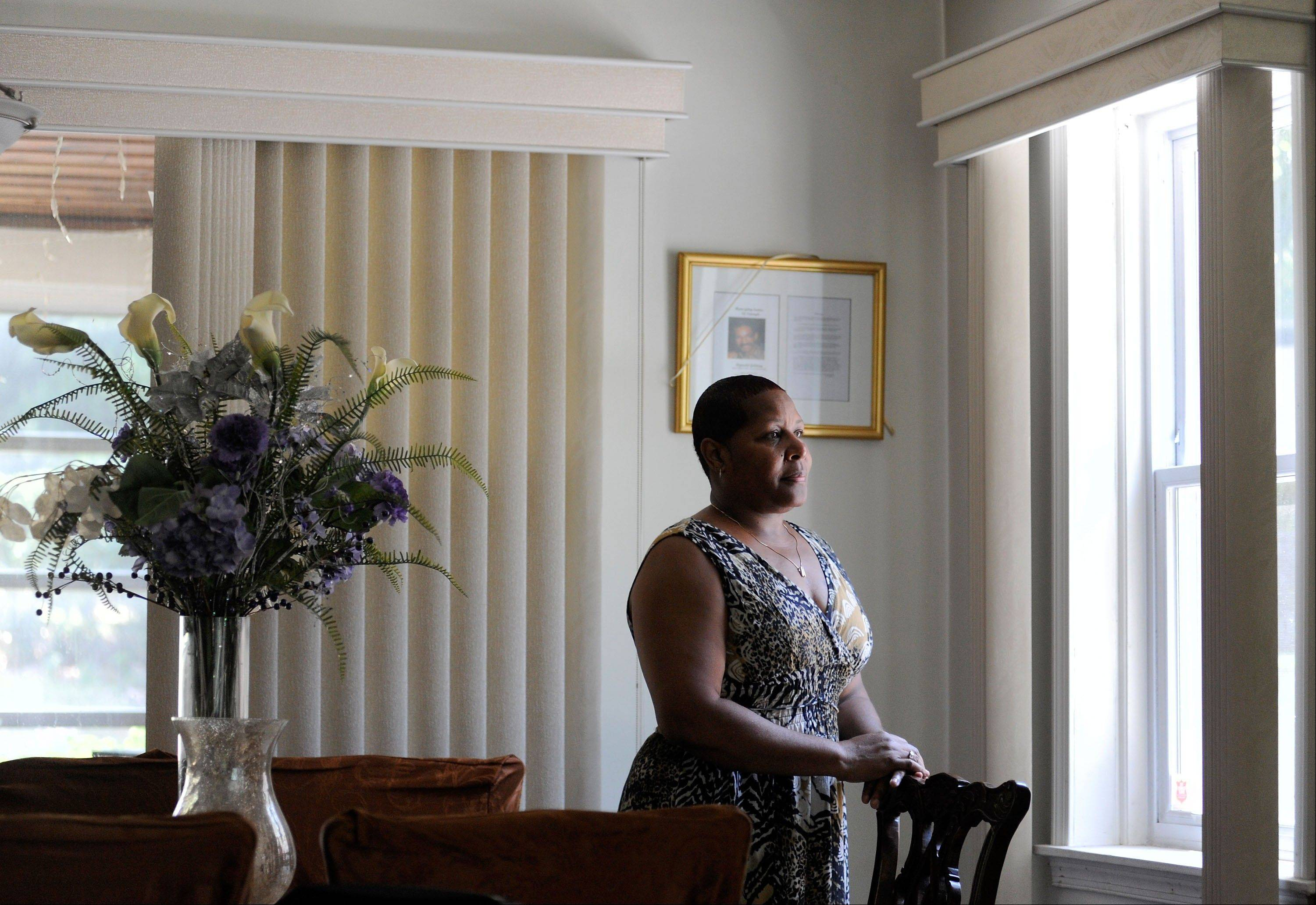 Deborah Goldring stands in the living room of her Baltimore home. From growing up black in the segregated 1960s, Goldring pulled herself out of poverty and earned a middle-class life -- until the Great Recession.