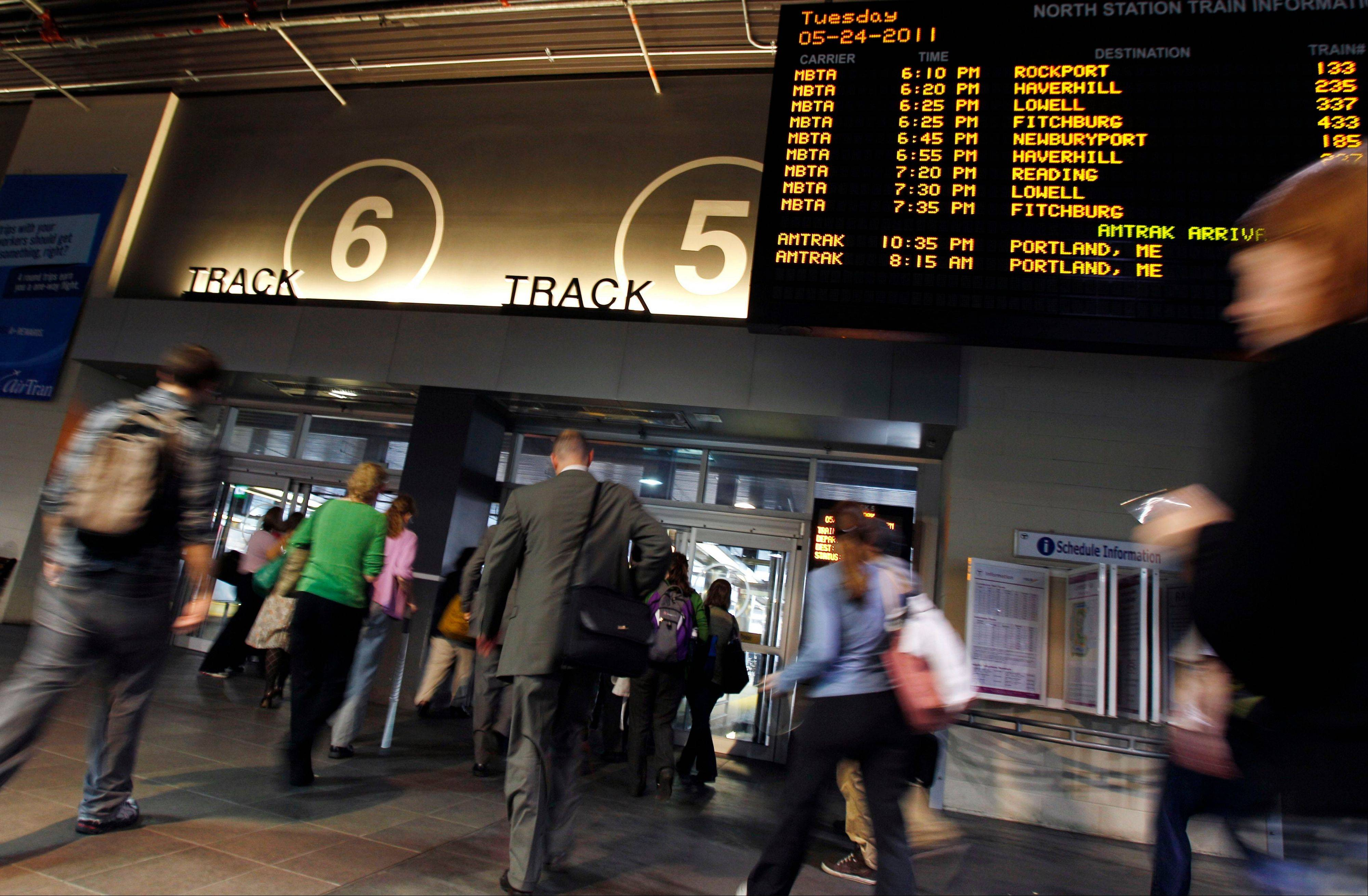 Commuters rush to catch trains at North Station in Boston. By one survey, more than 80 percent of U.S. transit systems had cut service, raised f