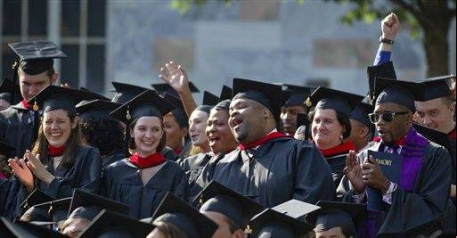 Graduates of the School of Theology celebrate during Emory University's commencement ceremony in May in Atlanta. School isn't over just yet for new college graduates. The next test is figuring out how to repay those student loans.