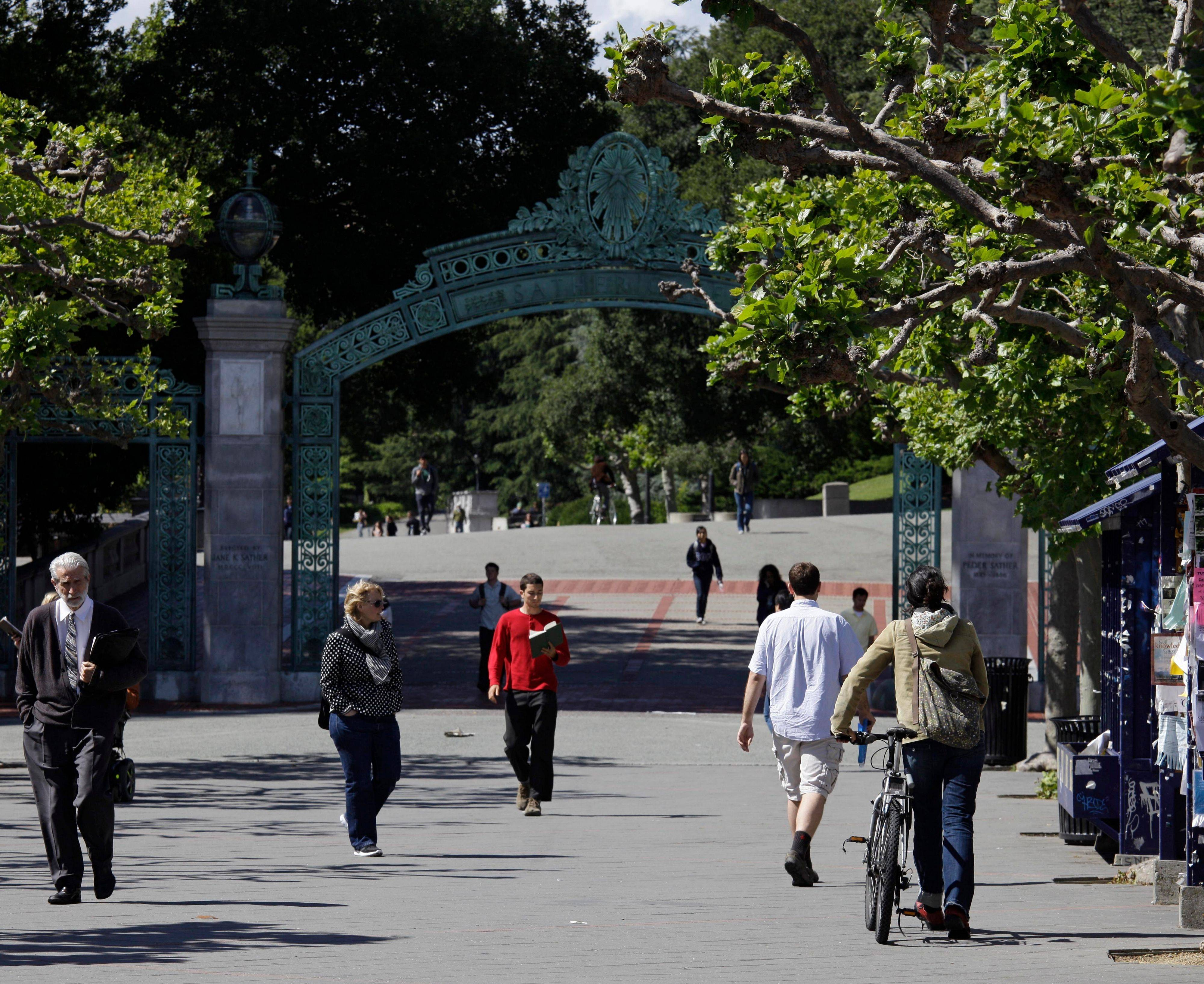 People stroll through Sproul Plaza near the Sather Gate on the University of California, Berkeley campus.