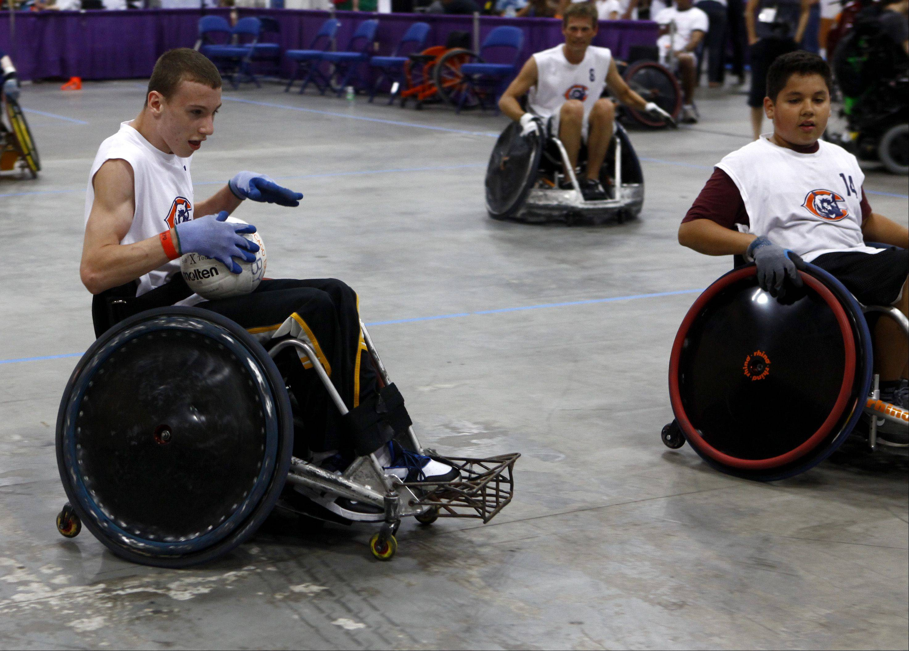 Matt Molenkamp, of Itasca, comes in for a goal during a game of wheelchair rugby at the annual Abilities Expo Sunday at the Schaumburg convention center. Molenkamp is part of the RIC Bears wheelchair rugby team.