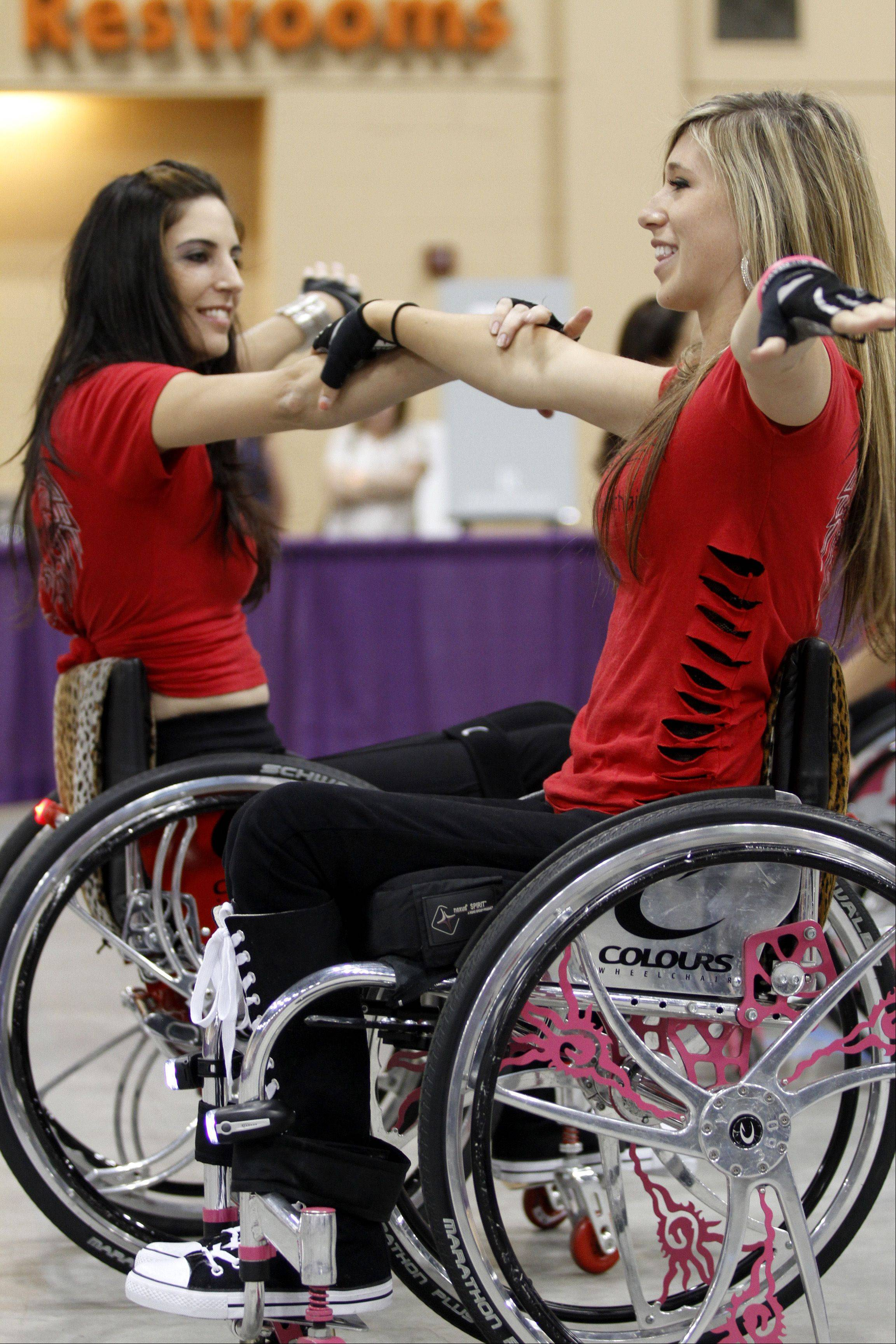 Chelsie Hill, right, from Monterey, Calif., and Mia Schailkewitz, from North Hollywood, Calif., perform a dance routine at the annual Abilities Expo on Sunday at the Schaumburg convention center. They are part of a wheelchair dance crew called Colors in Motion.
