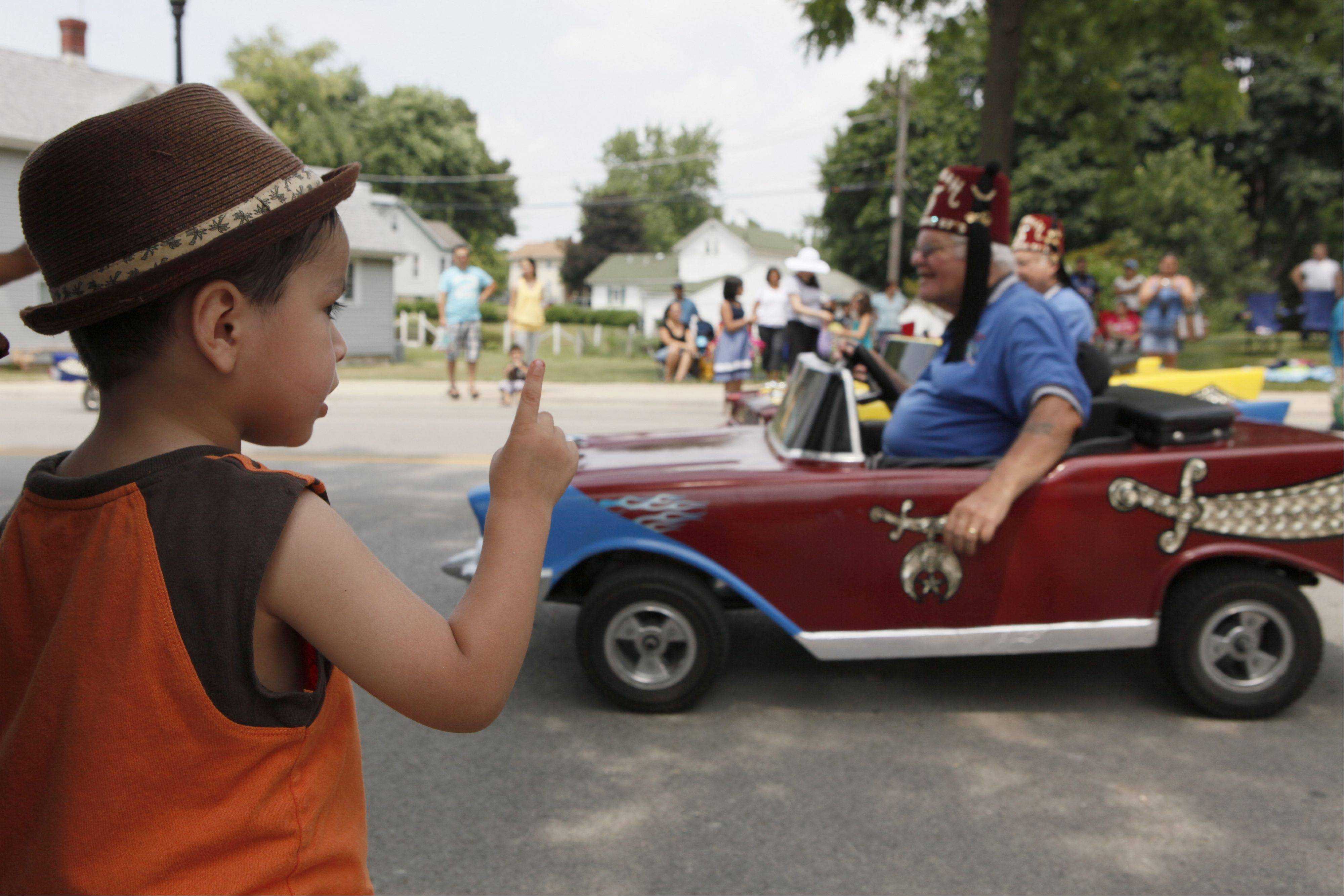 Elias Hewera, 2, watches as Medinah car club rides by in minicars at the West Chicago Railroad Days Parade Sunday.