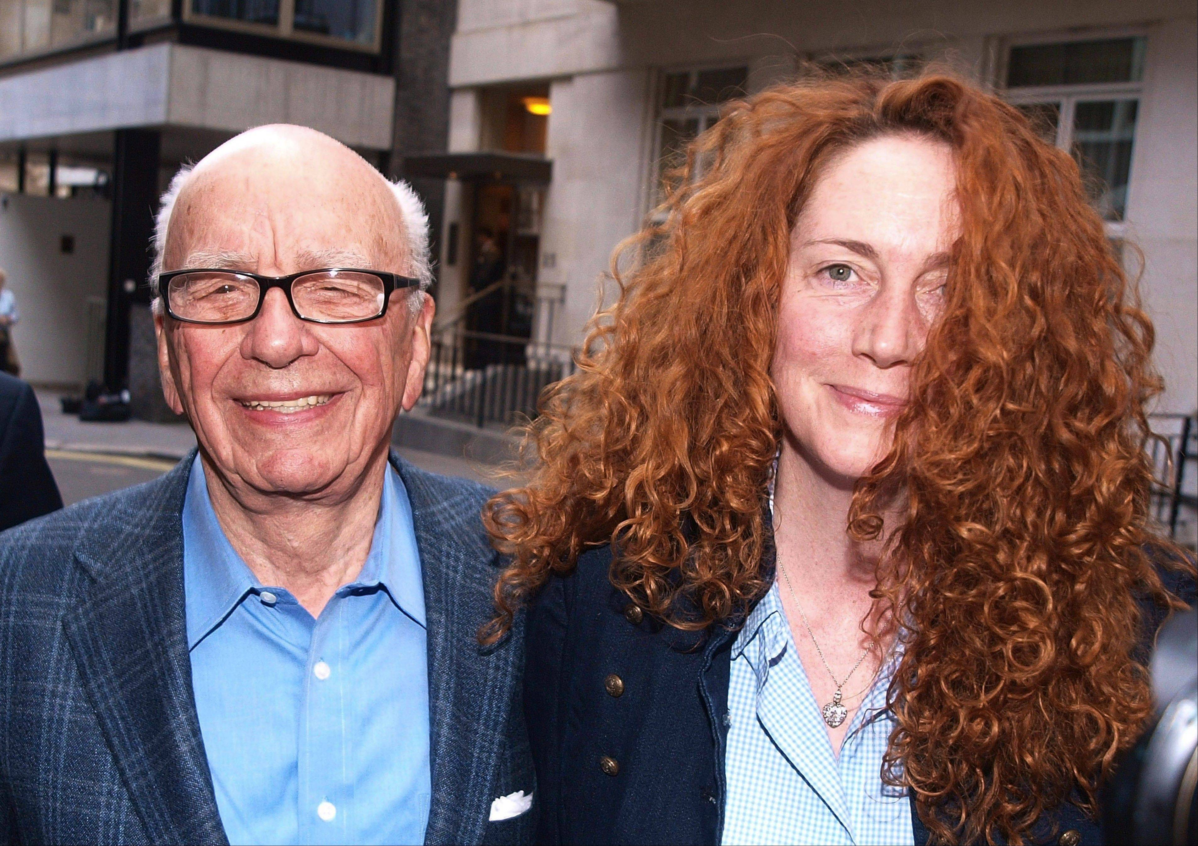 Chairman of News Corporation Rupert Murdoch, left, and Chief Executive of News International Rebekah Brooks met in London on Sunday -- the day on which Britain's tabloid newspaper News of the World ceased publication.