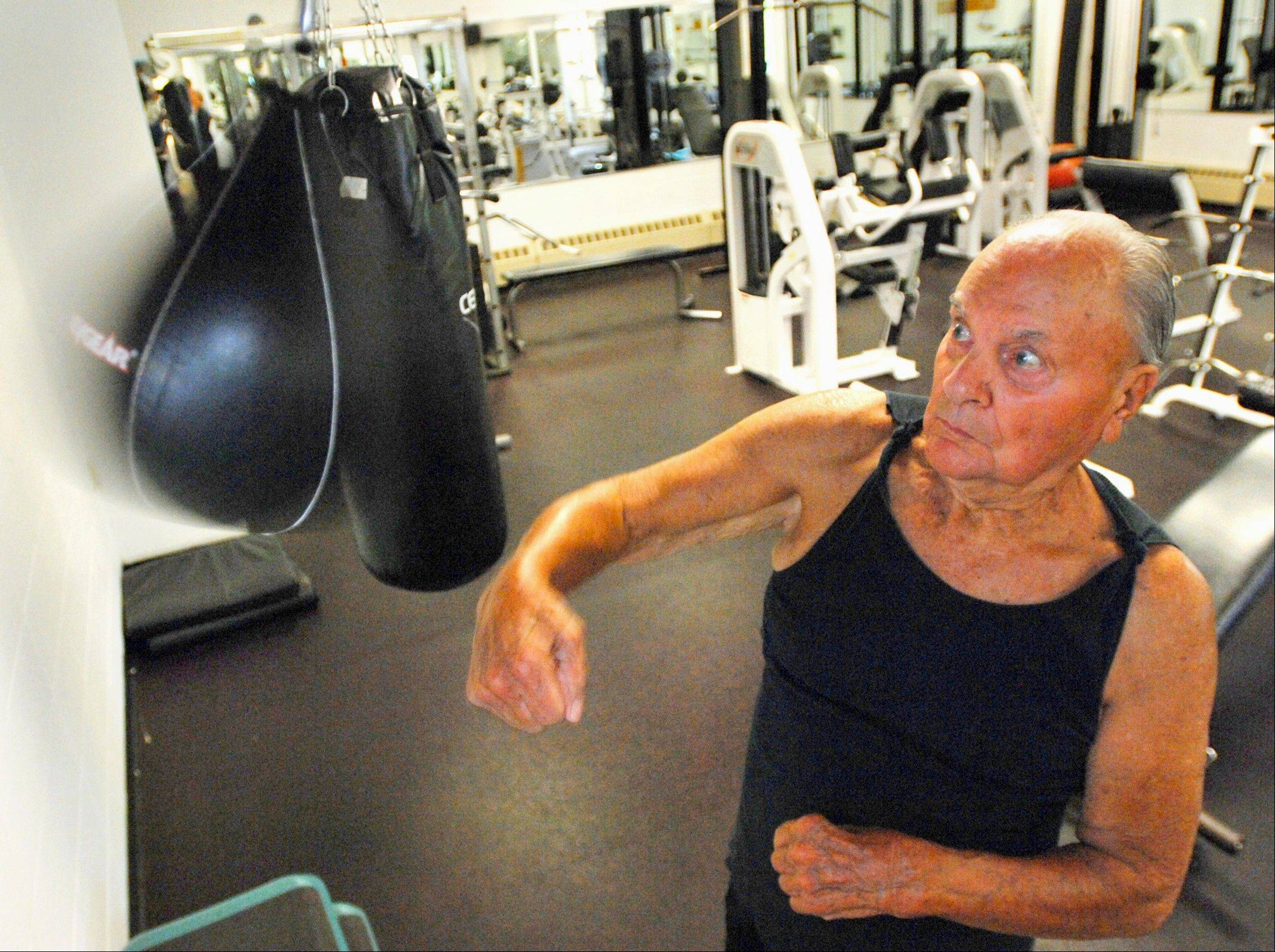 Retired farmer Glenn Bradd, 87, of Bloomington, Ill., uses a punching bag during a workout at the YMCA in Bloomington. Three days a week, he lifts weights, jumps rope, uses the punching bag, does sit-ups and stretching.