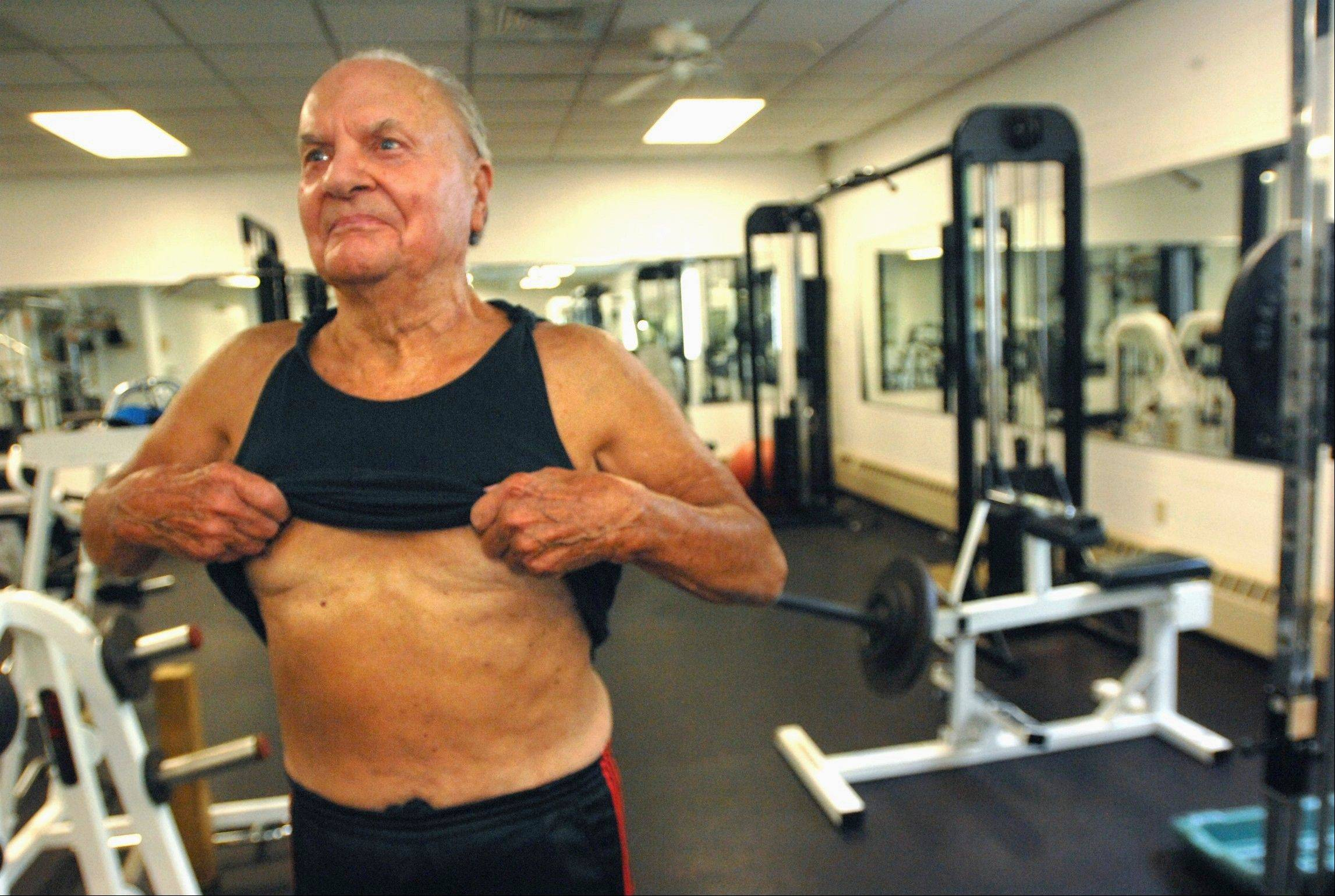 Retired farmer Glenn Bradd, 87, of Bloomington, Ill., shows off his abdominals after working out at the YMCA in Bloomington.