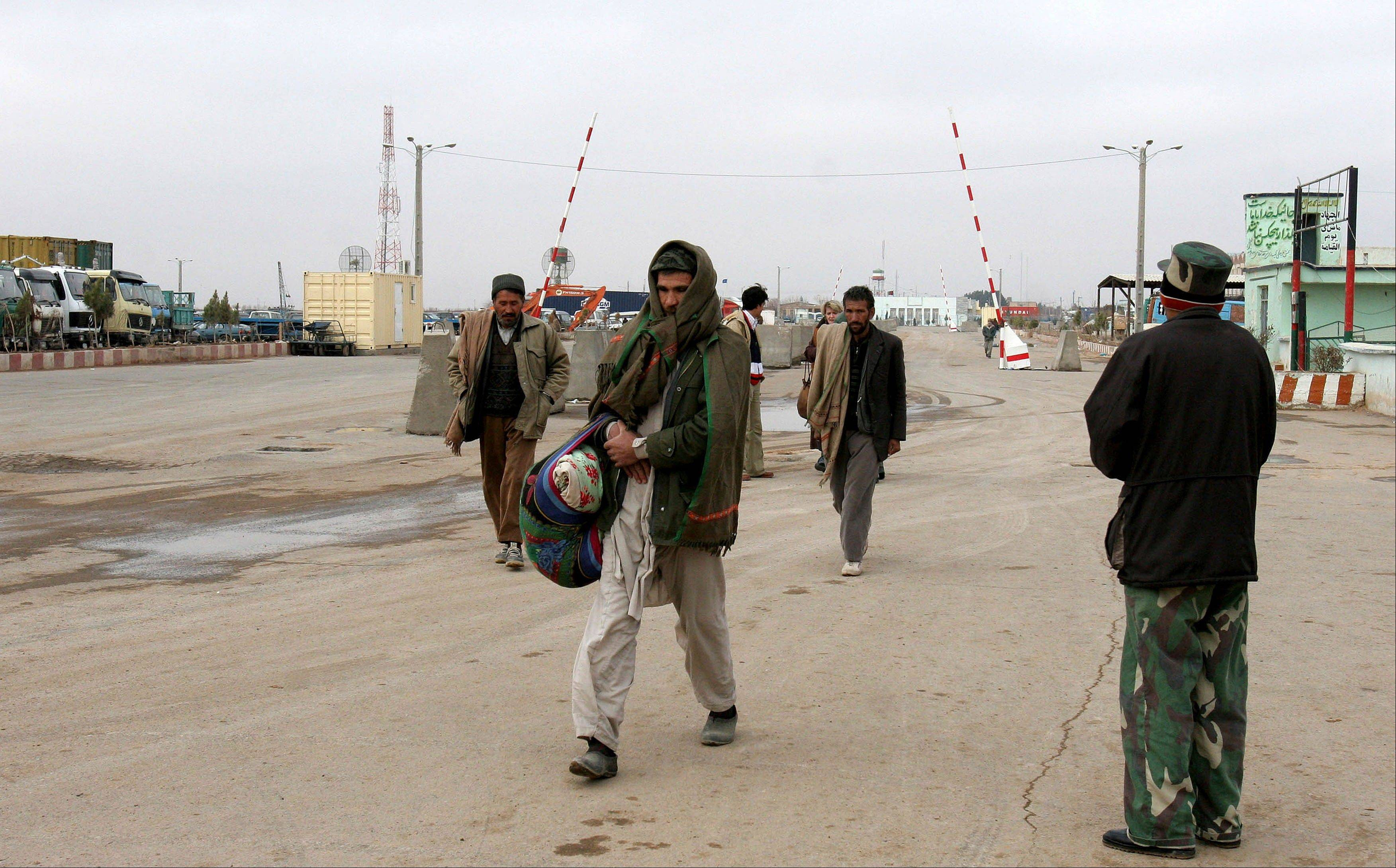 Men return to Afghanistan from Iran at Islam Kala, the largest border crossing in western Afghanistan, near Herat.