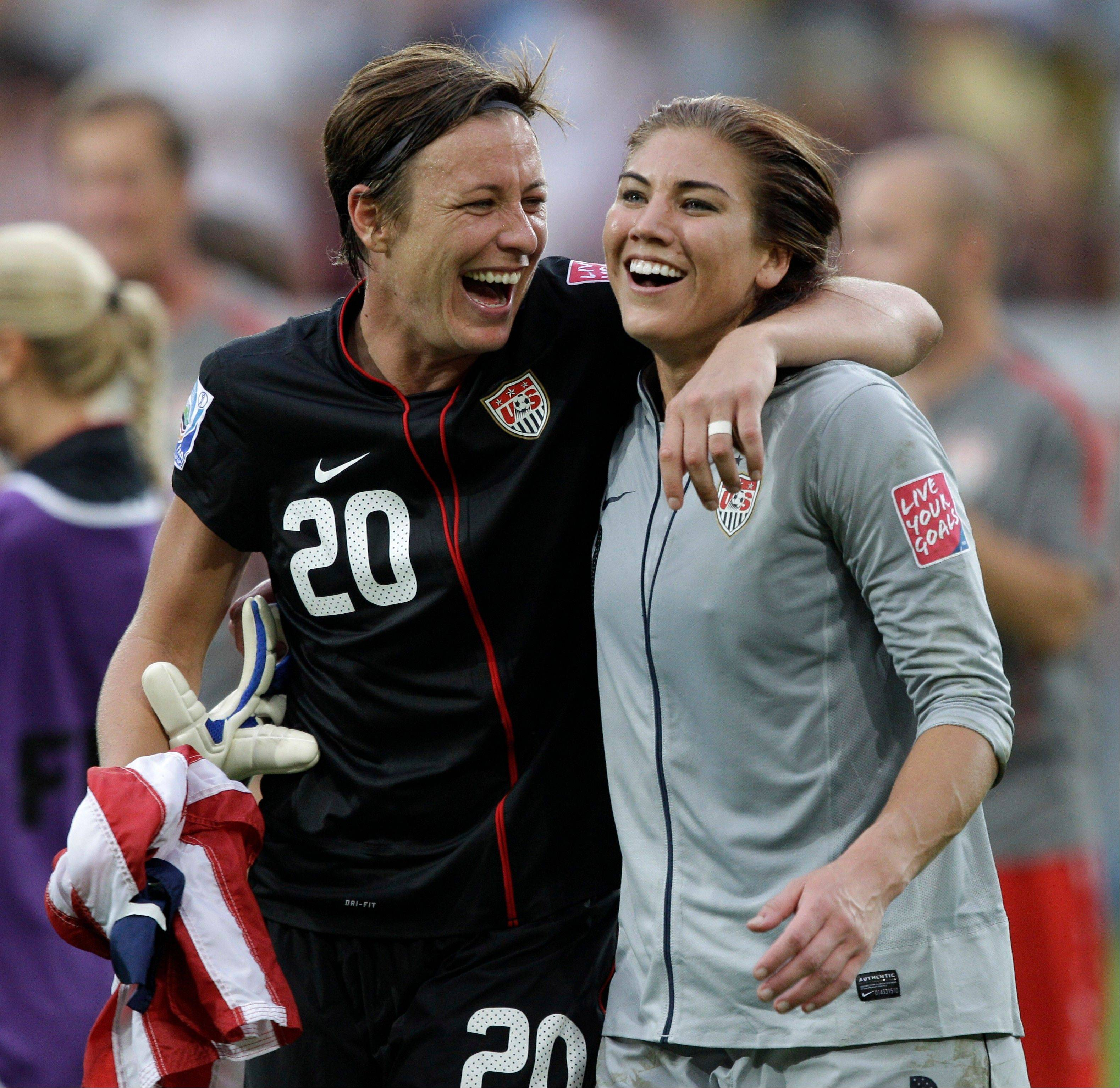 Abby Wambach, left, and goalkeeper Hope Solo celebrate Sunday's U.S. victory over Brazil.