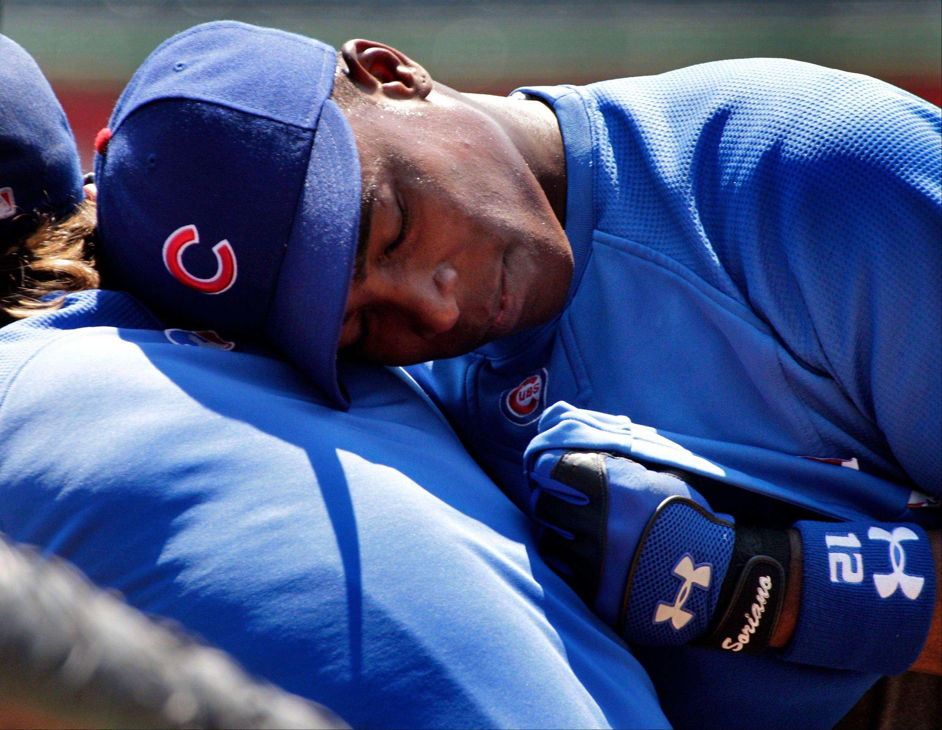 Cubs outfielder Alfonso Soriano leans on teammate Blake DeWitt on Sunday while waiting to hit during batting practice at PNC Park in Pittsburgh.