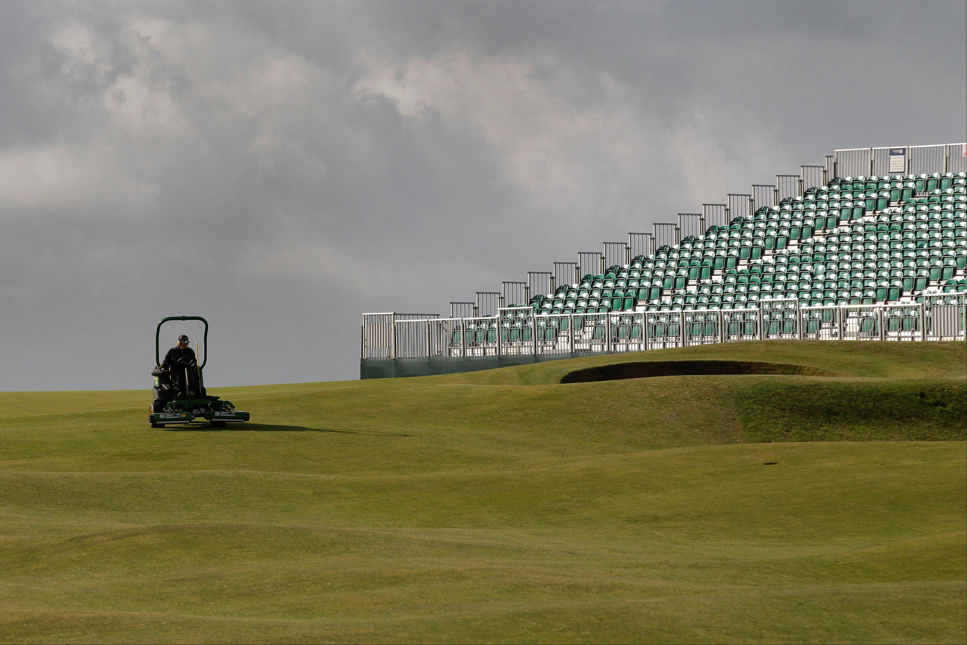 A member of the grounds crew prepares a green on the course in preparation for the British Open golf championship at the Royal St. George's Golf Club in Sandwich, England. The Open Championship is to be held on July 14-17.