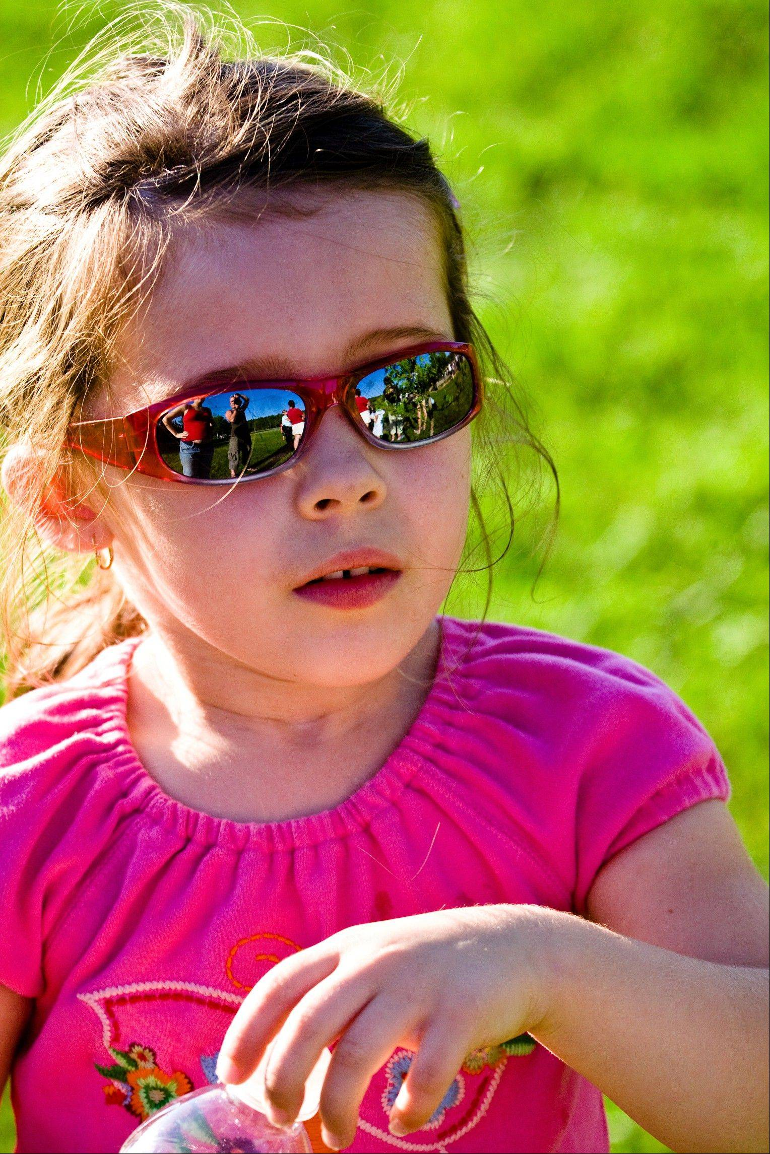 Wearing sunglasses can protect children from harmful UV exposure.