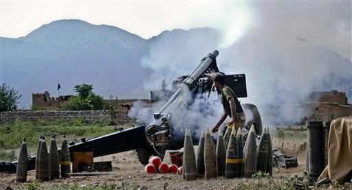 "A Pakistani army soldier fires an artillery shell toward a target at a forward base during a military operation against militants in Pakistan's Khurram tribal region, Saturday, July 9, 2011. ""A military operation in Kurram tribal region has been launched to clear the area of terrorists involved in all kinds of terrorist activities, including kidnapping and killing of locals, suicide attacks and blocking the road connecting Lower with upper Kurram,"" Pakistani army spokesman Maj. Gen. Athar Abbas said."