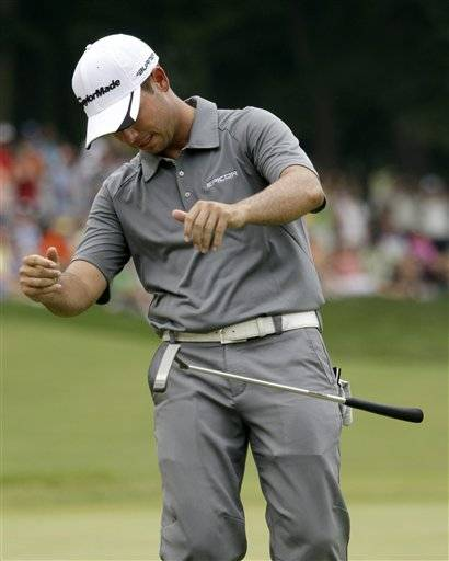 Chez Reavie reacts after missing a putt on the eighteenth green during the final round of the John Deere Classic golf tournament at TPC Deere Run Sunday in Silvis, Ill. Reavie finished tied 5th.