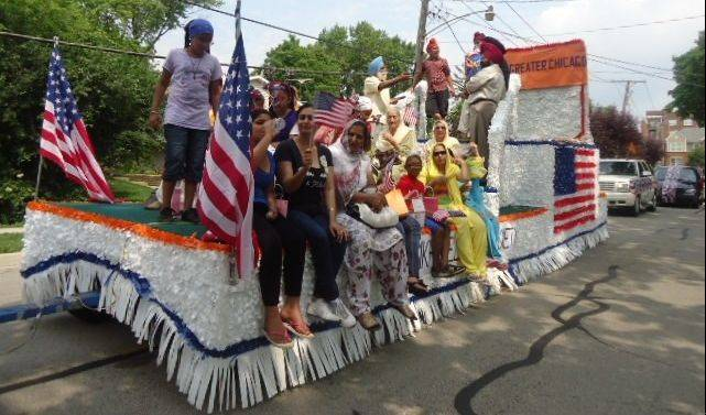 At left, Palatine Gurudwara displayed its presence in the village of Palatine�s Independence Day Parade with a colorfully decorated float. At right, Sikh men, women, and children of all ages dressed in ethnic dresses march in the parade. The colorful turbans and women�s dupattas stood out in the parade.