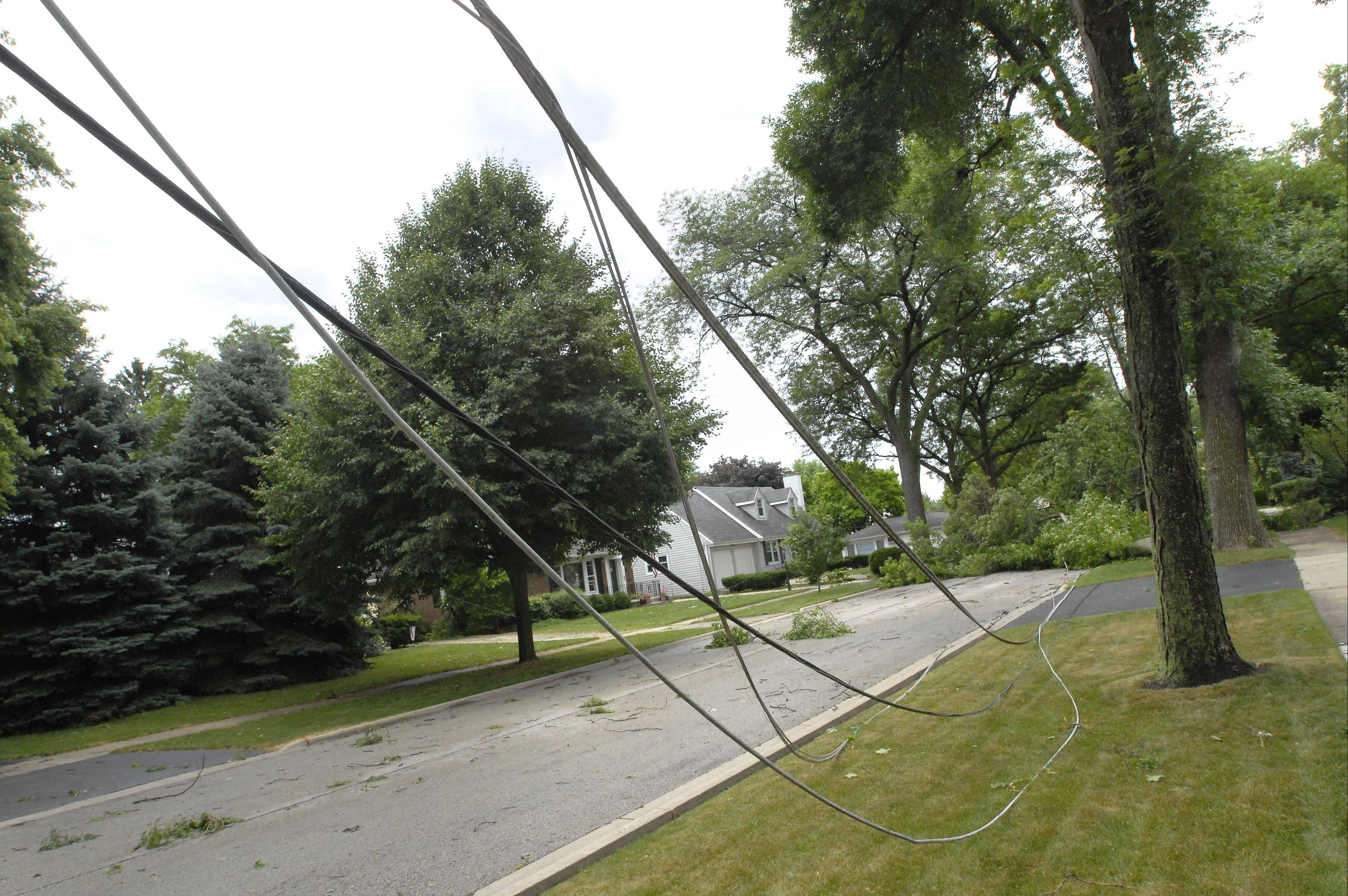 Power lines were snapped on Kennicott Avenue at Wing Street in Arlington Heights after a thunderstorm producing winds reported at 70 mph Monday morning.