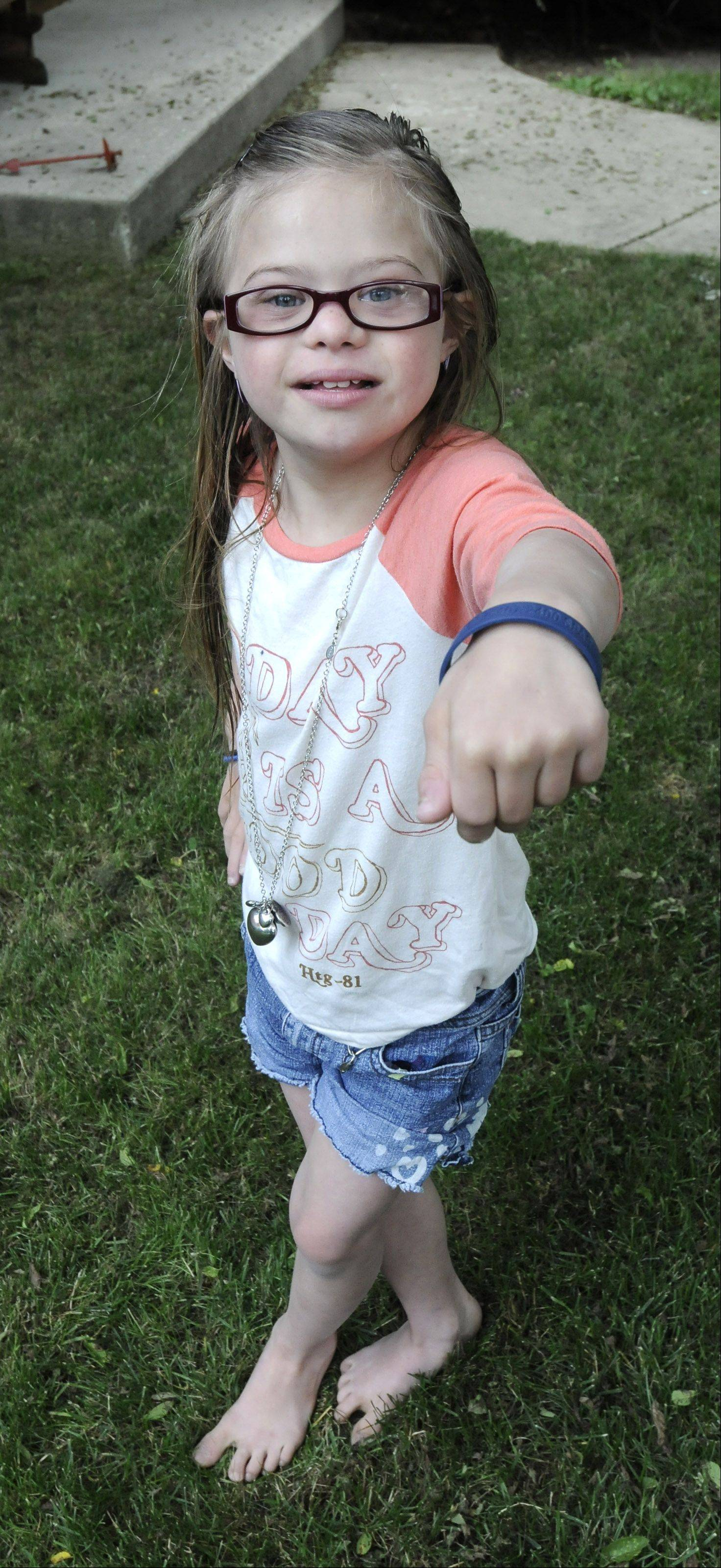 Sara Davis, 9, who lives near Downers Grove, displays her SPARR wristband, which alerts people to call the DuPage County Sheriff's Office if she ever gets lost.