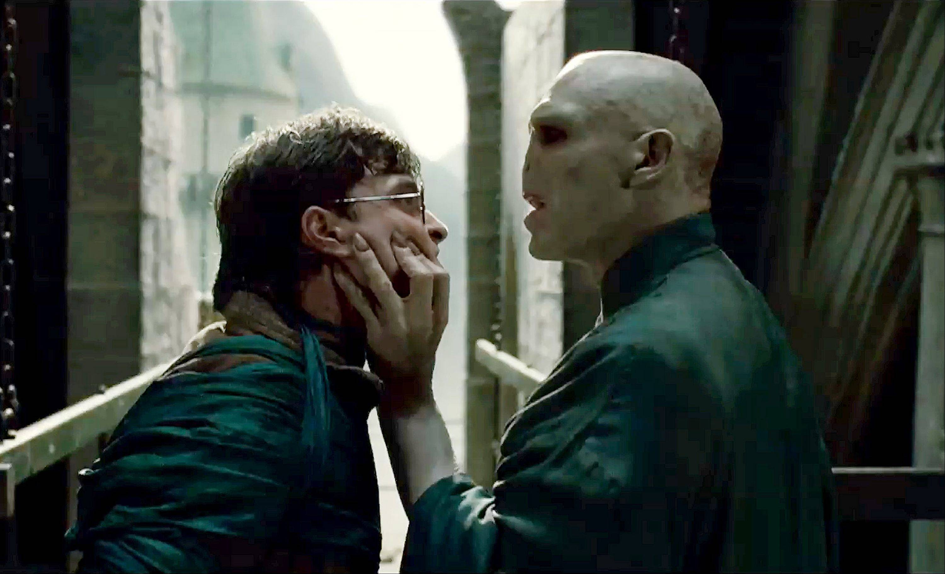"Harry (Daniel Radcliffe), left, must confront Voldemort (Ralph Fiennes) in ""Harry Potter and the Deathly Hallows — Part 2."" Some suburban theaters will be holding ""Harry Potter"" marathons before the premiere of ""Part 2"" Friday."