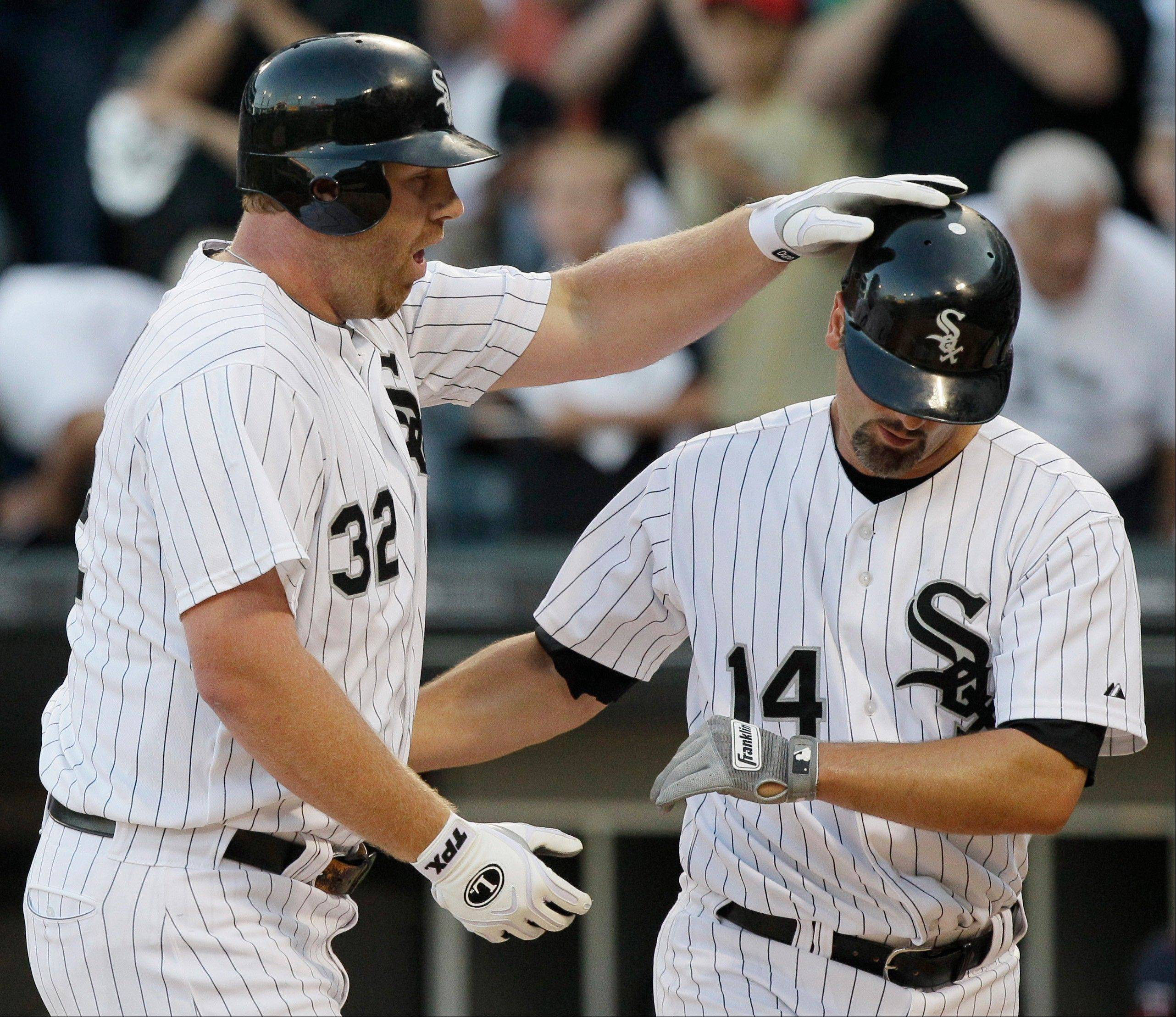 White Sox DH Adam Dunn, left, gets an F for the first half, and first baseman Paul Konerko, here hitting a 2-run homer, gets an A+.
