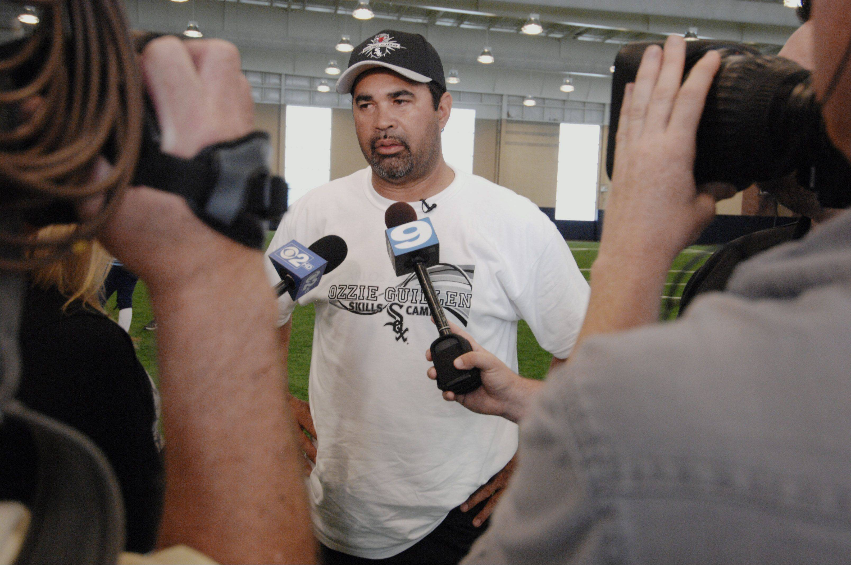 White Sox manager Ozzie Guillen talks with the media Monday after working with kids attending the Bulls/Sox Academy in Glen Ellyn.