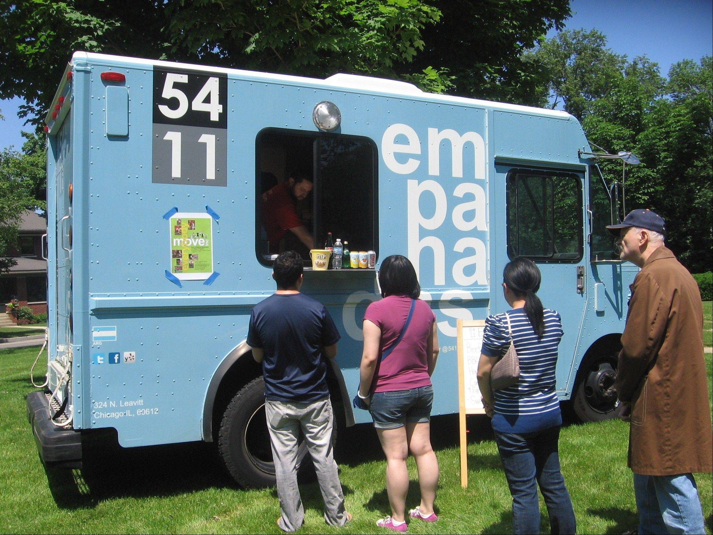 "The 5411 food truck sells gourmet empanadas that customers describe as ""amazing"" during a small festival in Evanston. While many food trucks don't venture out to the suburbs, others say the area is ripe for more competition."