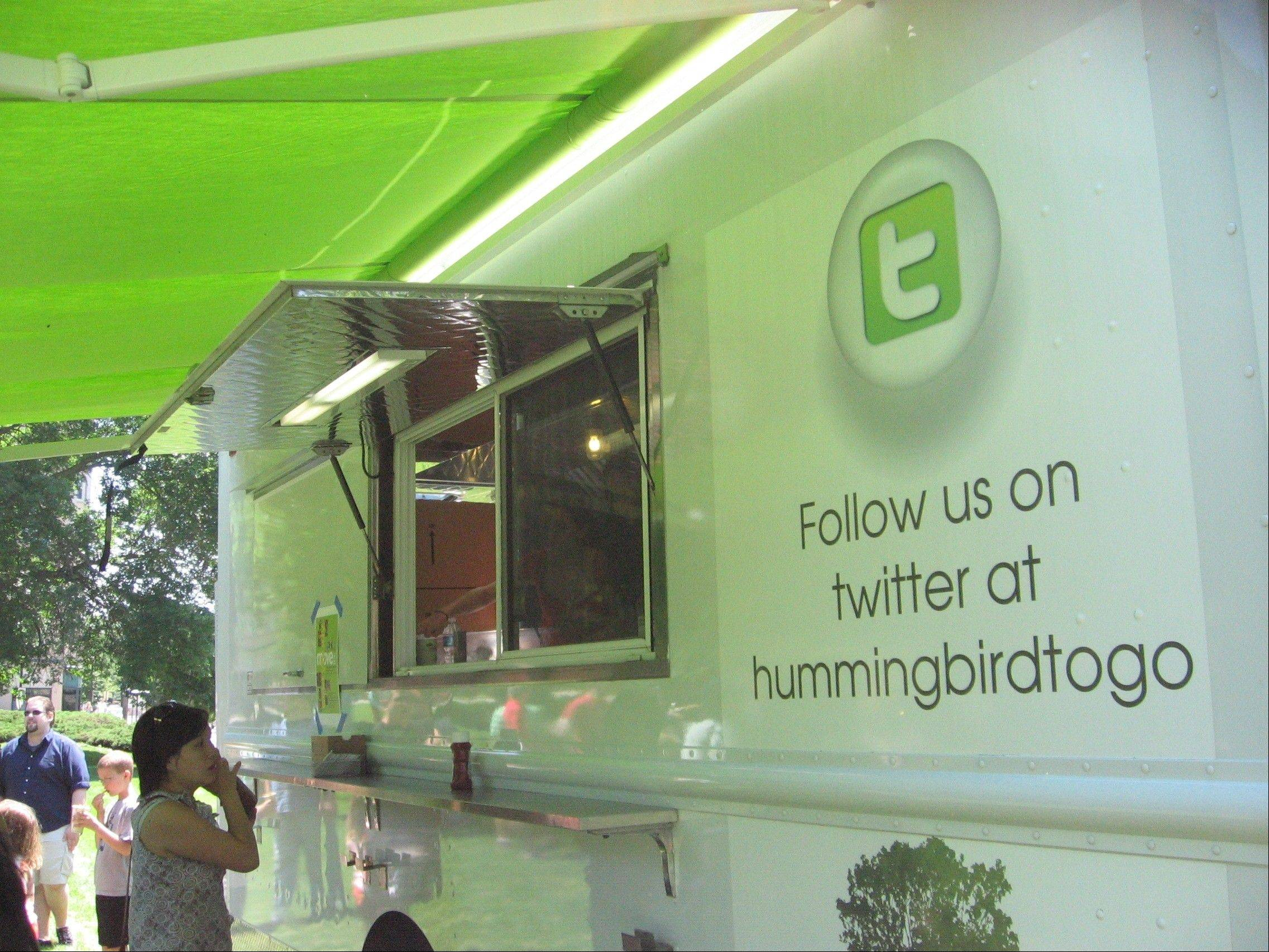 People line up for freshly made food from the Hummingbird Kitchen food truck during a June 26 festival in Evanston.