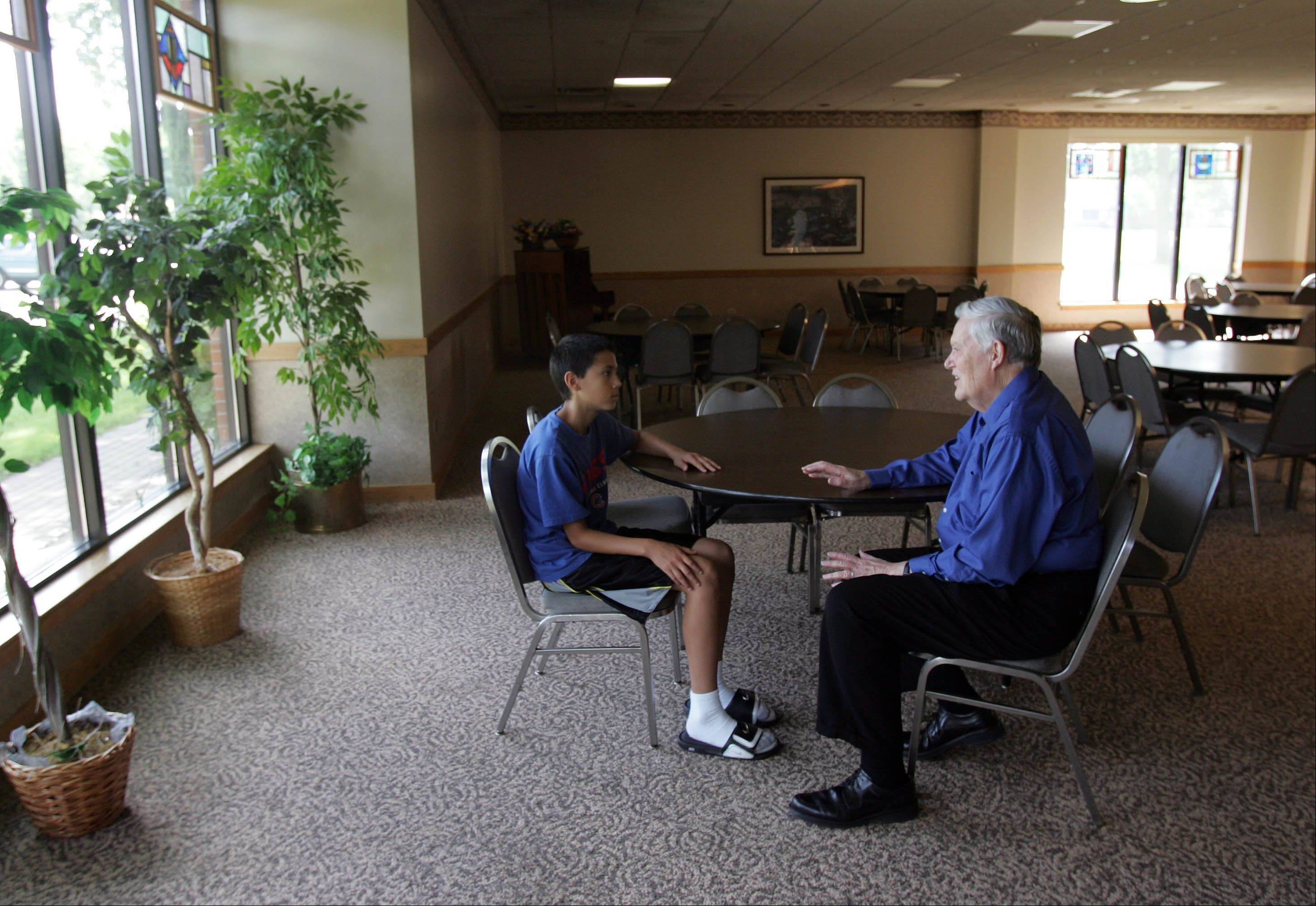 Ken Black, right, and Joey Sandoval have some private time together. During the school year, mentors meet one-on-one with students during one lunch period per week.