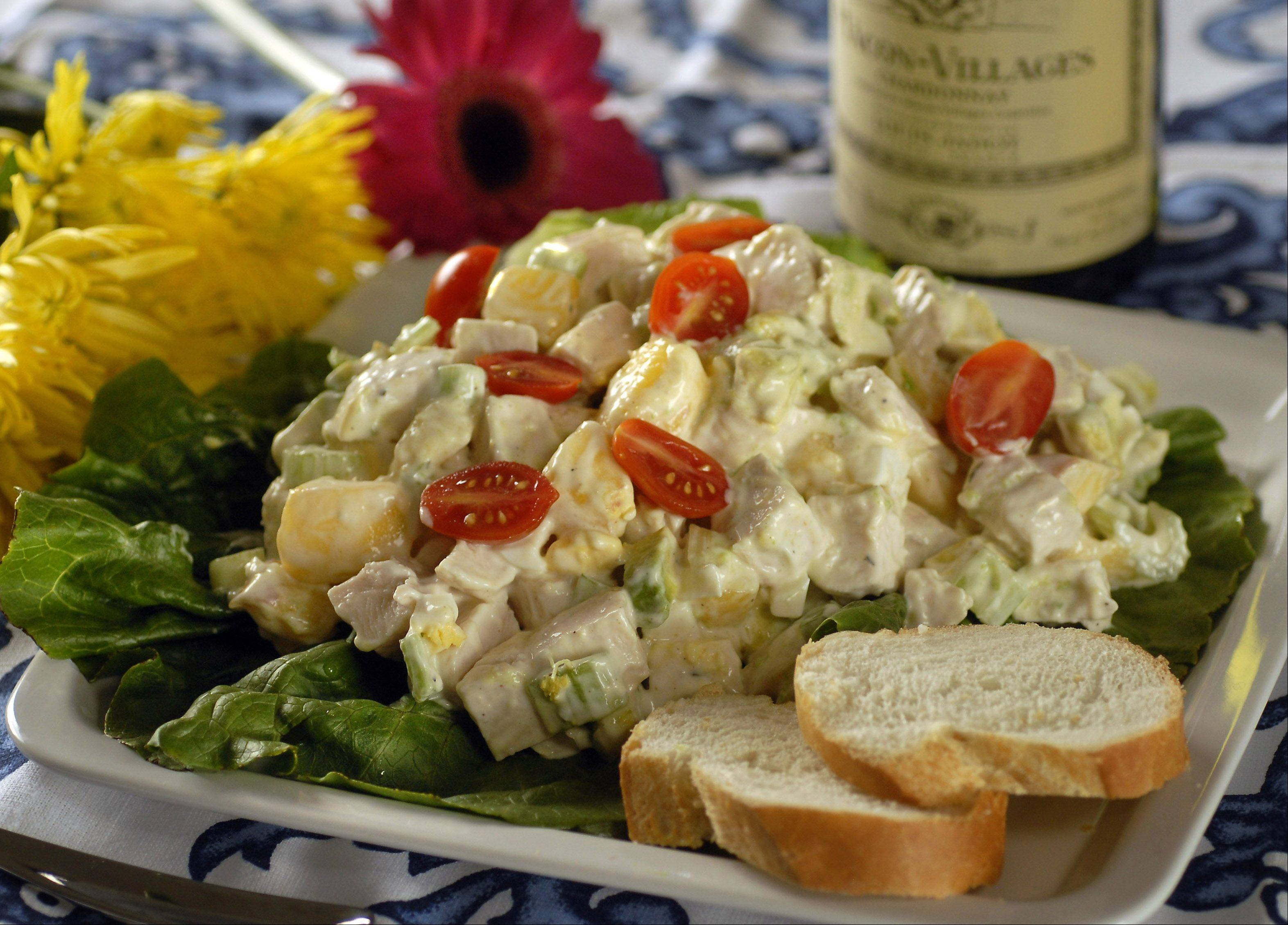 "Fresh peaches and tomatoes mingle in a summery chicken salad from Richard Grausman's ""French Classics Made Easy."""