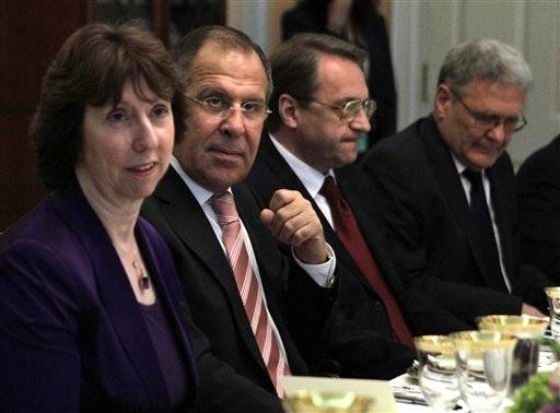 European Union High Representative Catherine Ashton, left, Russian Foreign Minister Sergey Lavrov, Russian Deputy Foreign Minister Mikhail Bogdanov, and Russian Ambassador Sergei Yakovlev, attend a dinner at the State Department in Washington, on Monday, July 11, 2011.