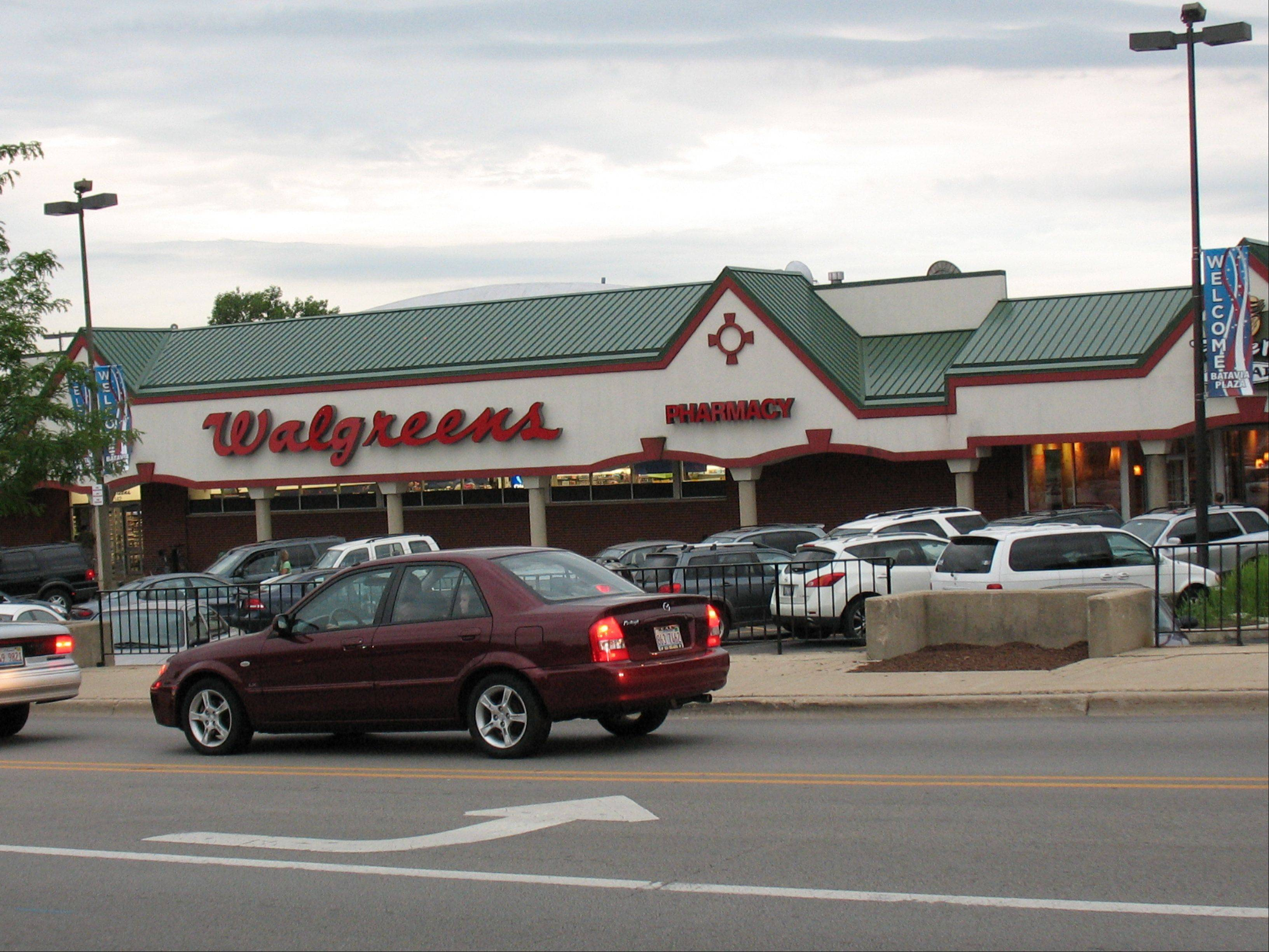 The current Walgreens store in Batavia Plaza in downtown Batavia. The company is proposing to build a replacement store just to the east, on the site where Prairie Path Cyclery stands.