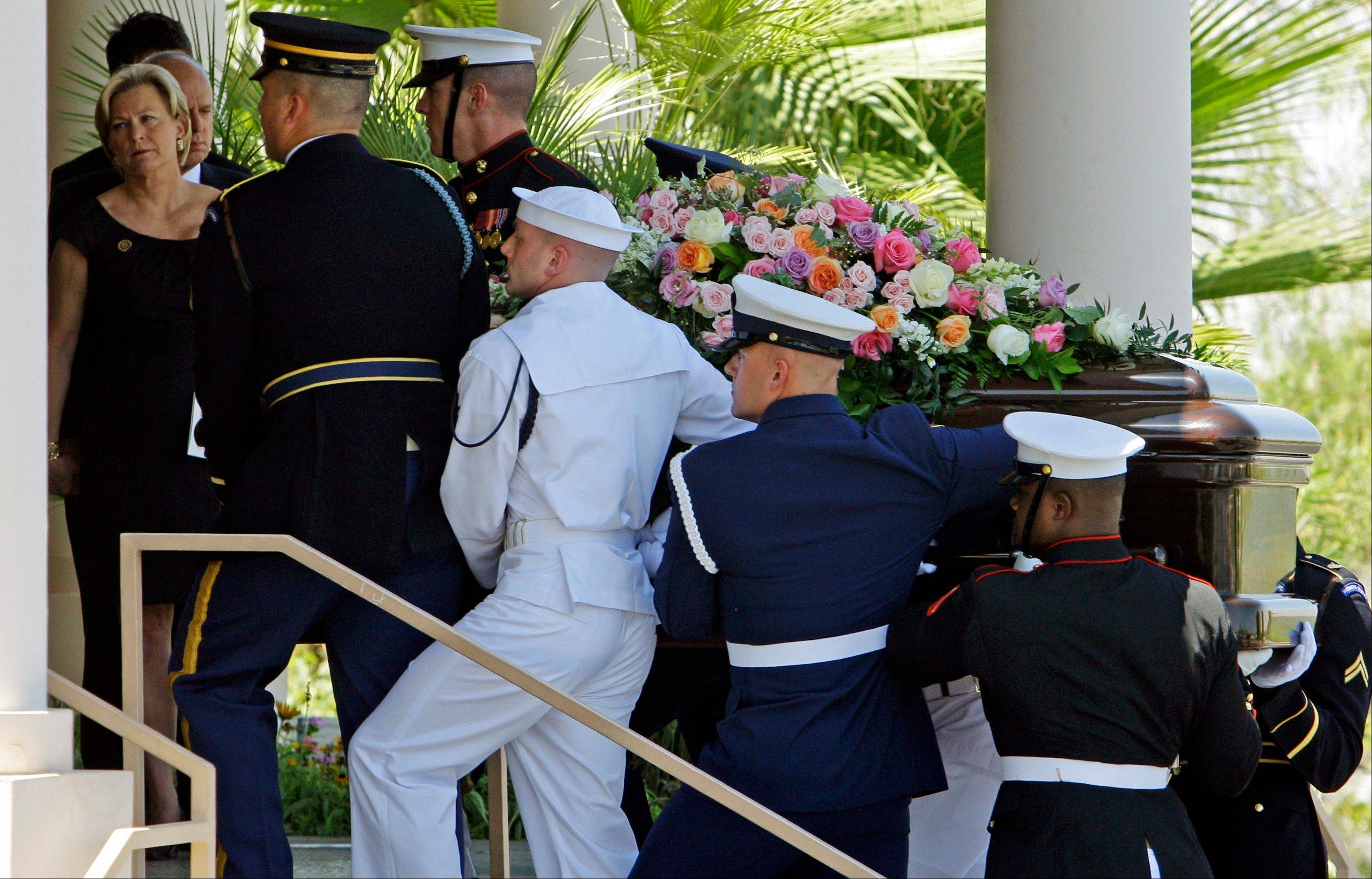 A military honor guard carries the casket of former first lady Betty Ford into her funeral at St. Margaret's Episcopal Church in Palm Desert, Calif., on Tuesday.