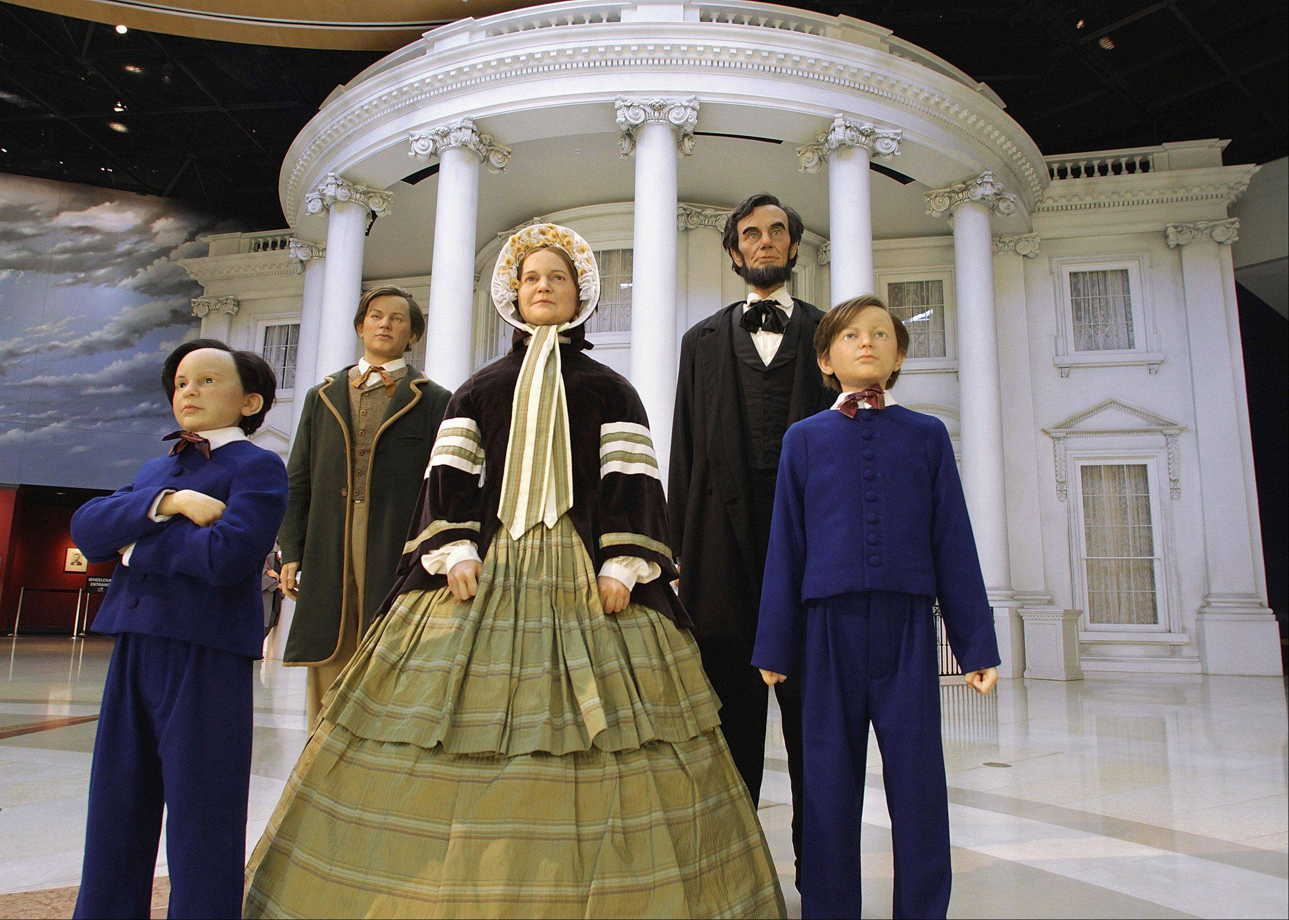 Life-like models of Abraham and Mary Lincoln, with their sons, Willie, Tad and Robert, pose in front of the 1861 White House facade in the central plaza area of the Abraham Lincoln Presidential Museum in Springfield, Ill.