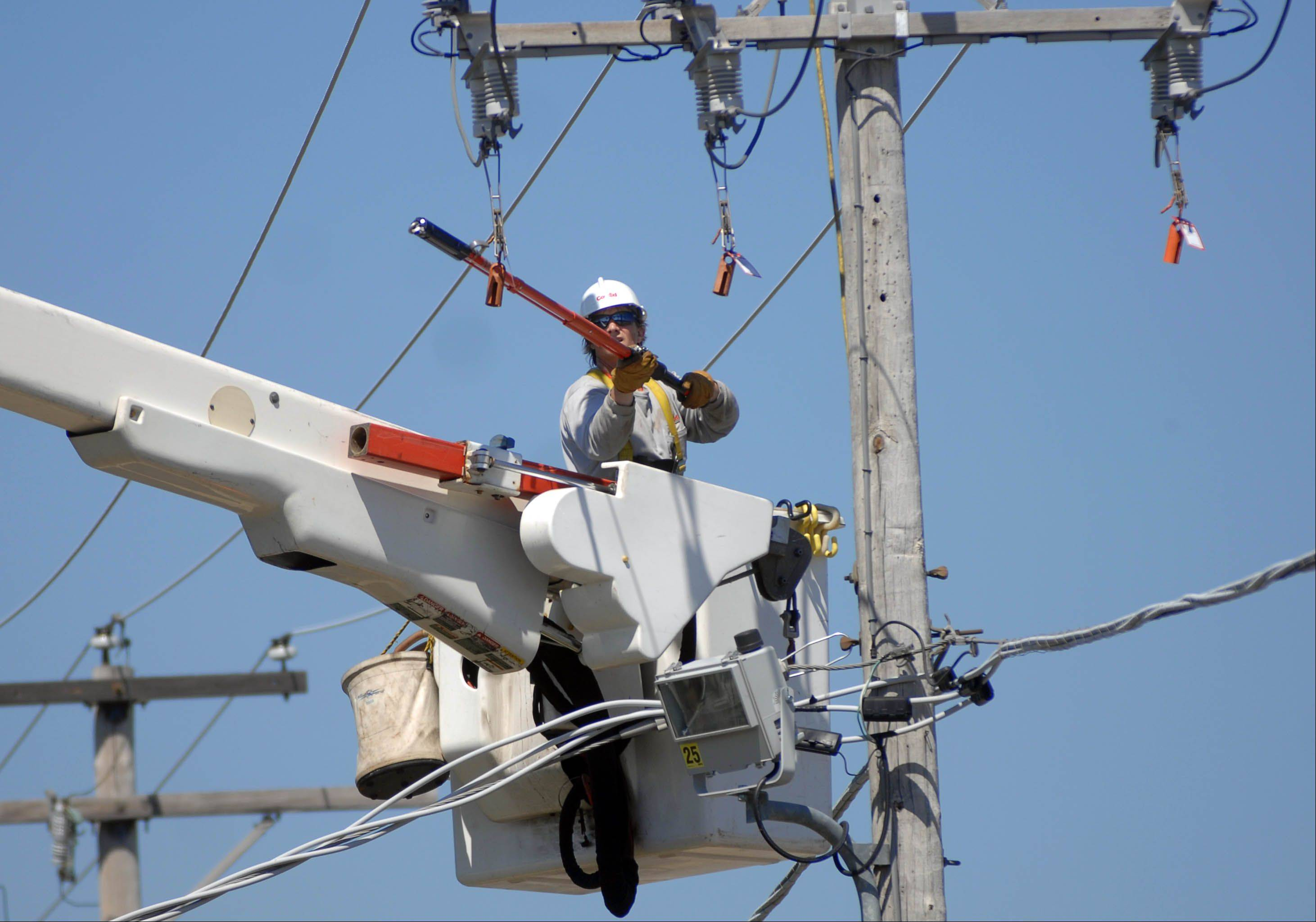 ComEd worker Jason Schmidt is part of a Highland Park crew working to restore power in Lake Villa Tuesday morning.