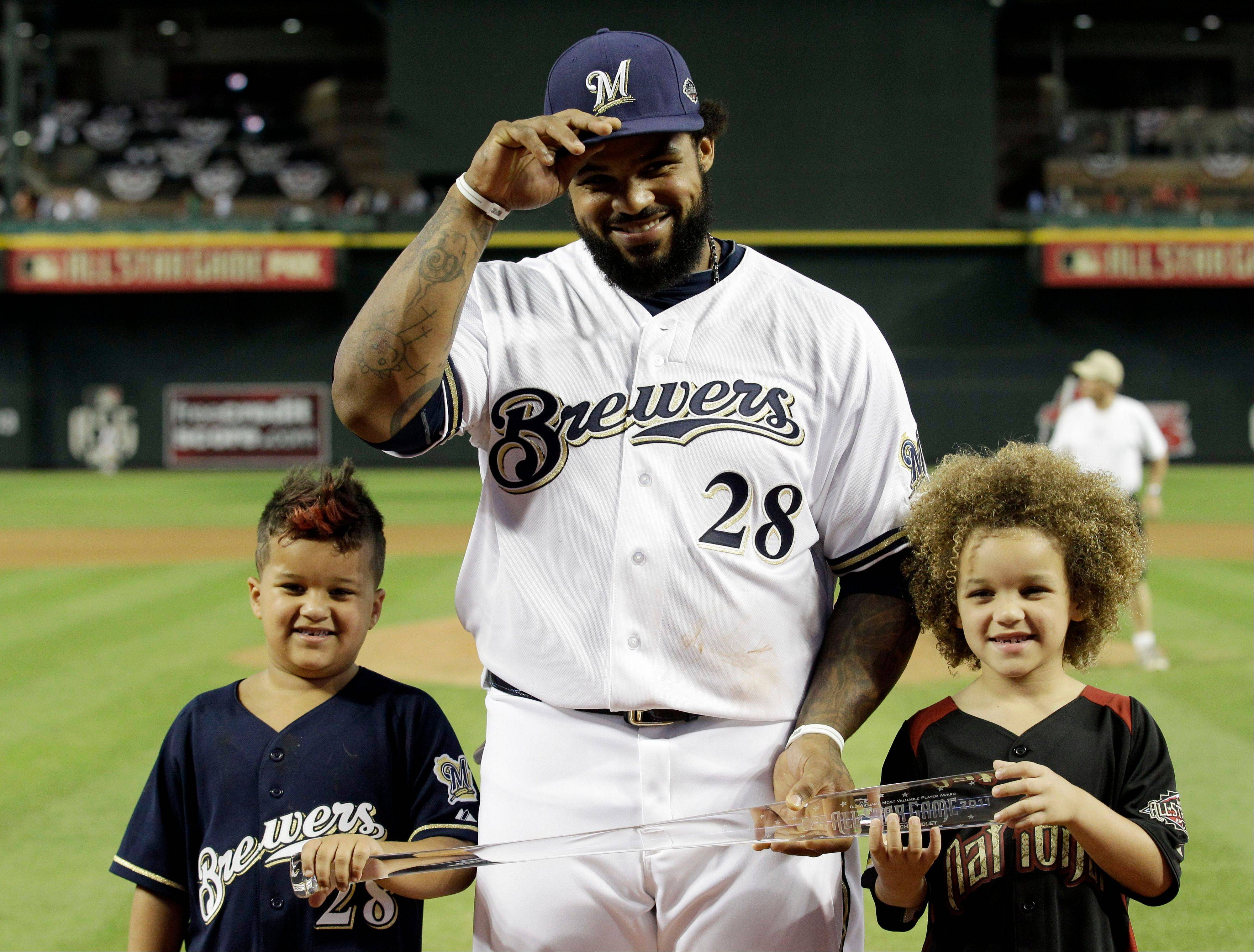 Flanked by his sons Haven, left, and Jaden, right, Prince Fielder of the Milwaukee Brewers holds his MVP award Tuesday after hitting a home run in the MLB All-Star game in Phoenix. The National League won 5-1.