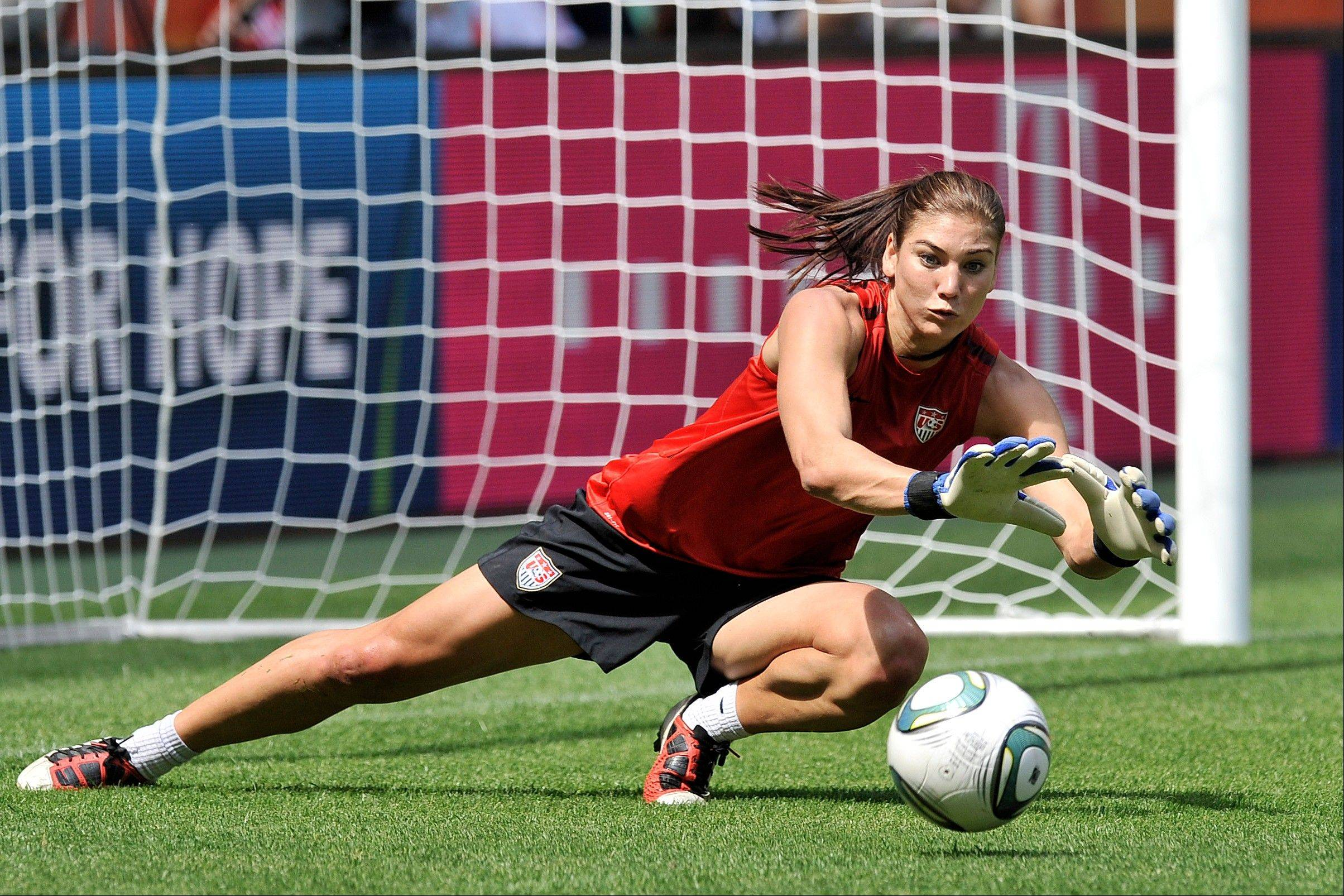 U.S. goalkeeper Hope Solo stops a shot during Tuesday's practice for today's match against France.