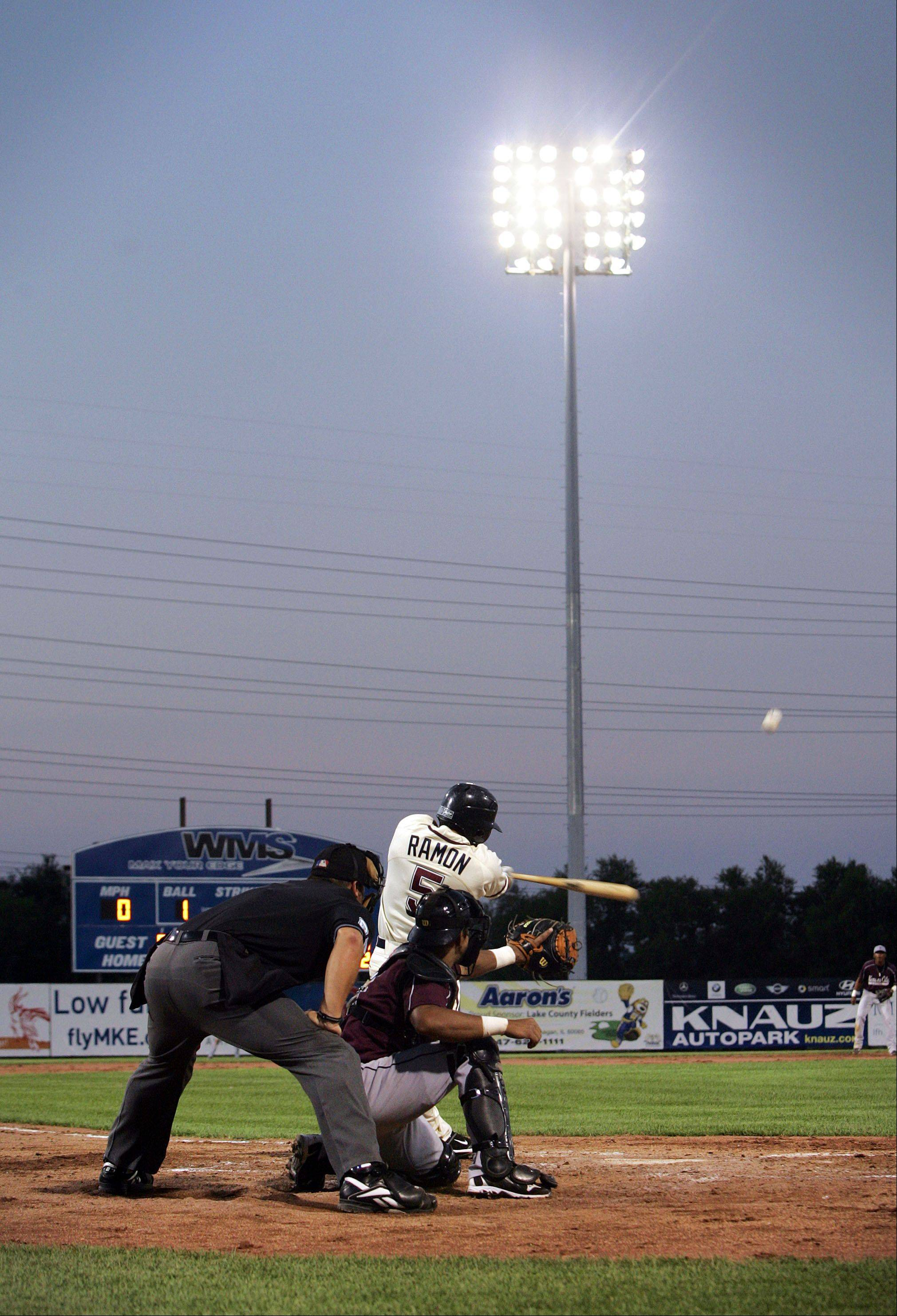 Amos Ramon connects with the ball as the Lake County Fielders played the Kansas City T-bones in the first night game at a Zion diamond in the 2010. Last year was the Fielders' inaugural season.