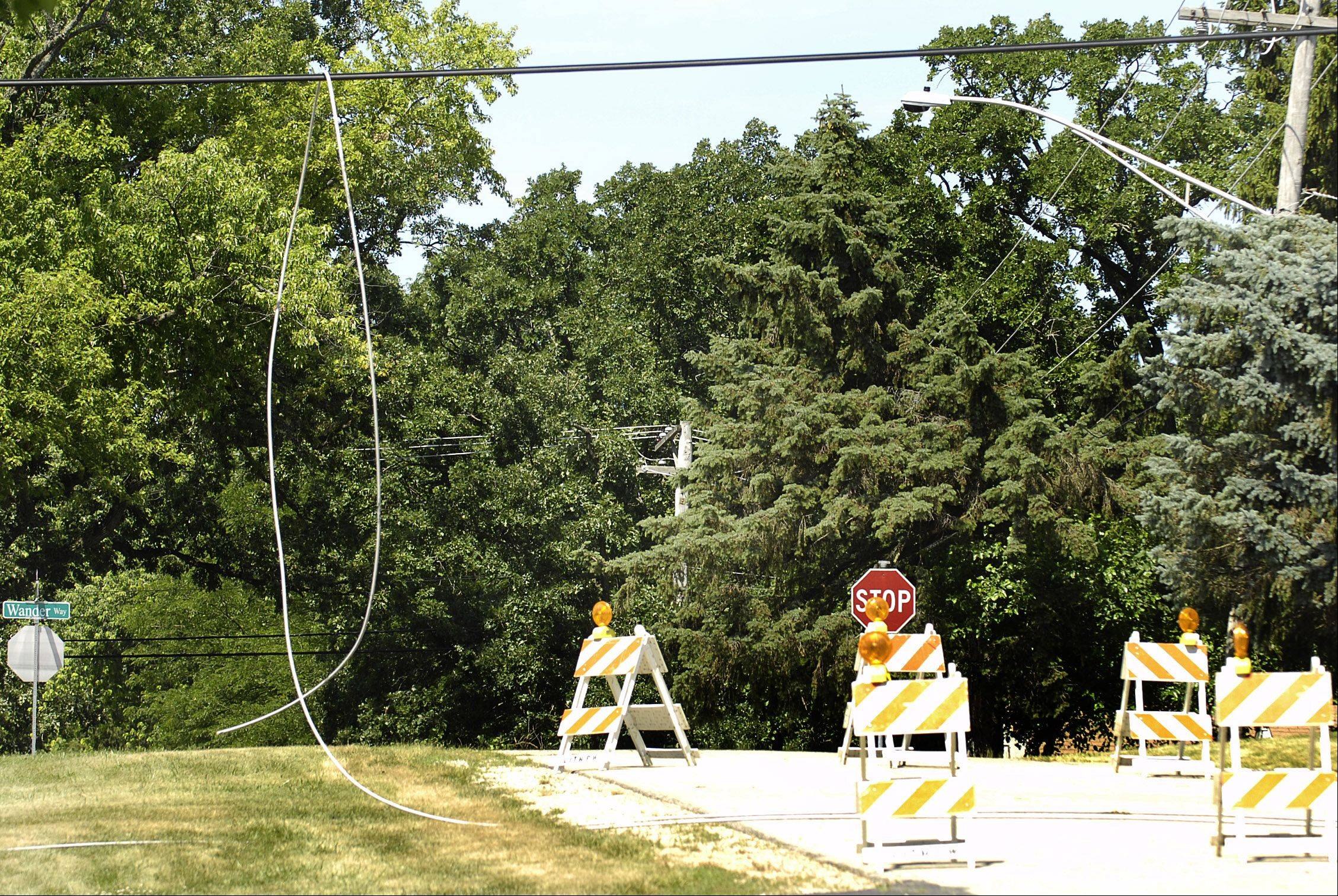 Hunters Path in Lake in the Hills is closed as a wire hangs over the road Tuesday.