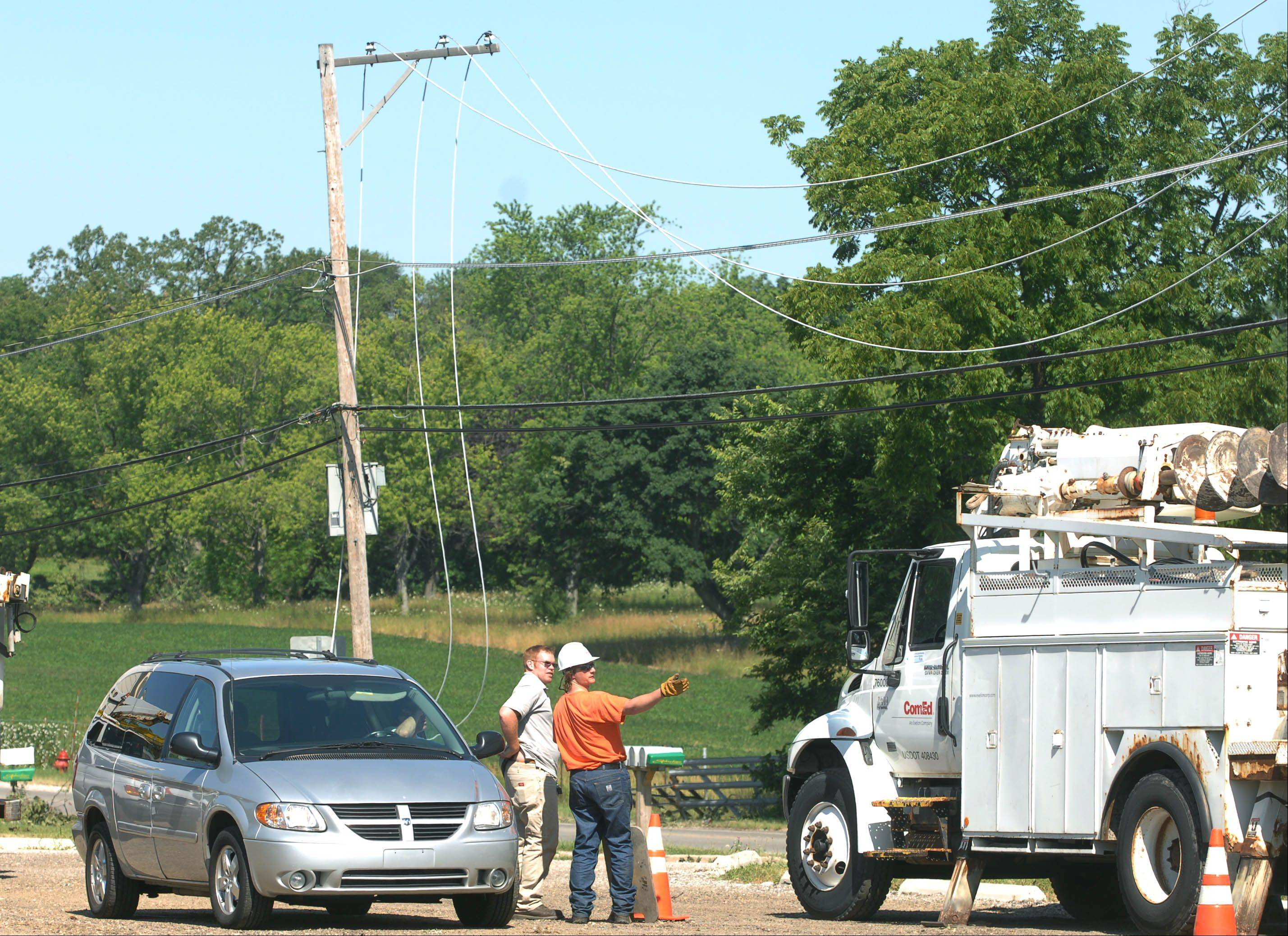 ComEd crews on the scene of downed power lines at Grand and Cedar Avenues in downtown Lake Villa Tuesday morning.