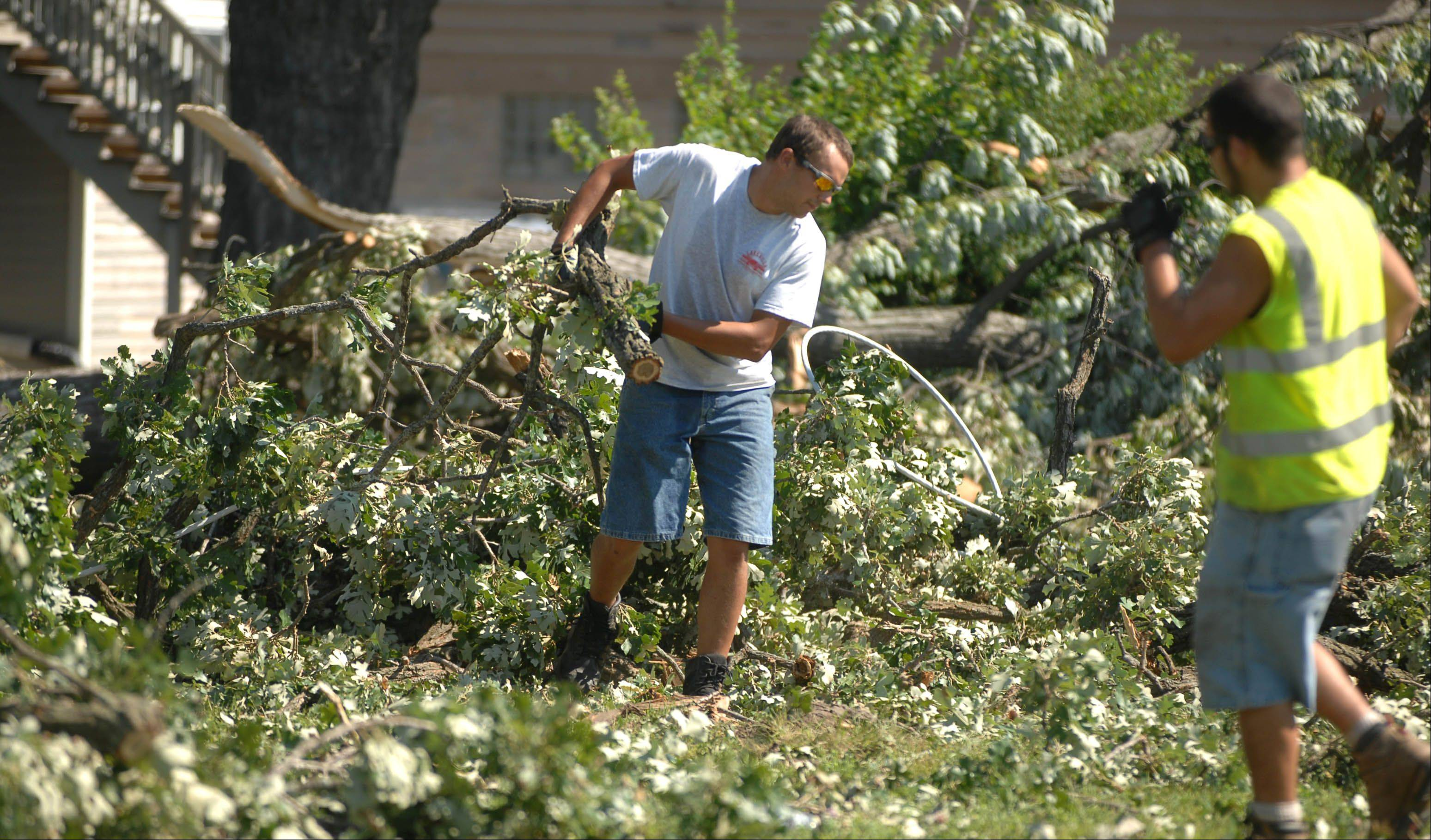 Lake Villa Public Works crews continue clean up along Grand Ave. Tuesday morning following Monday's storm.