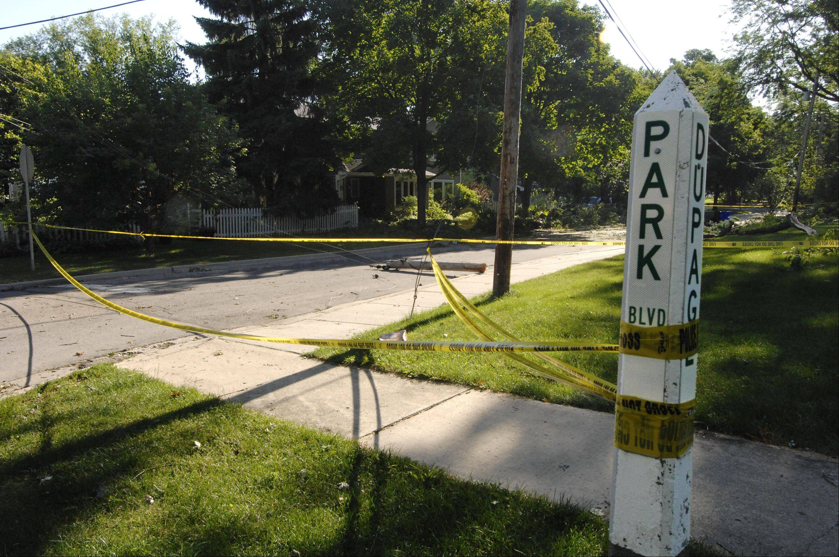Areas in Glen Ellyn are still affected by yesterday's storm such as the intersection of Park Blvd., and DuPage Blvd., where part of a power line pole still lays in the street, which is closed.