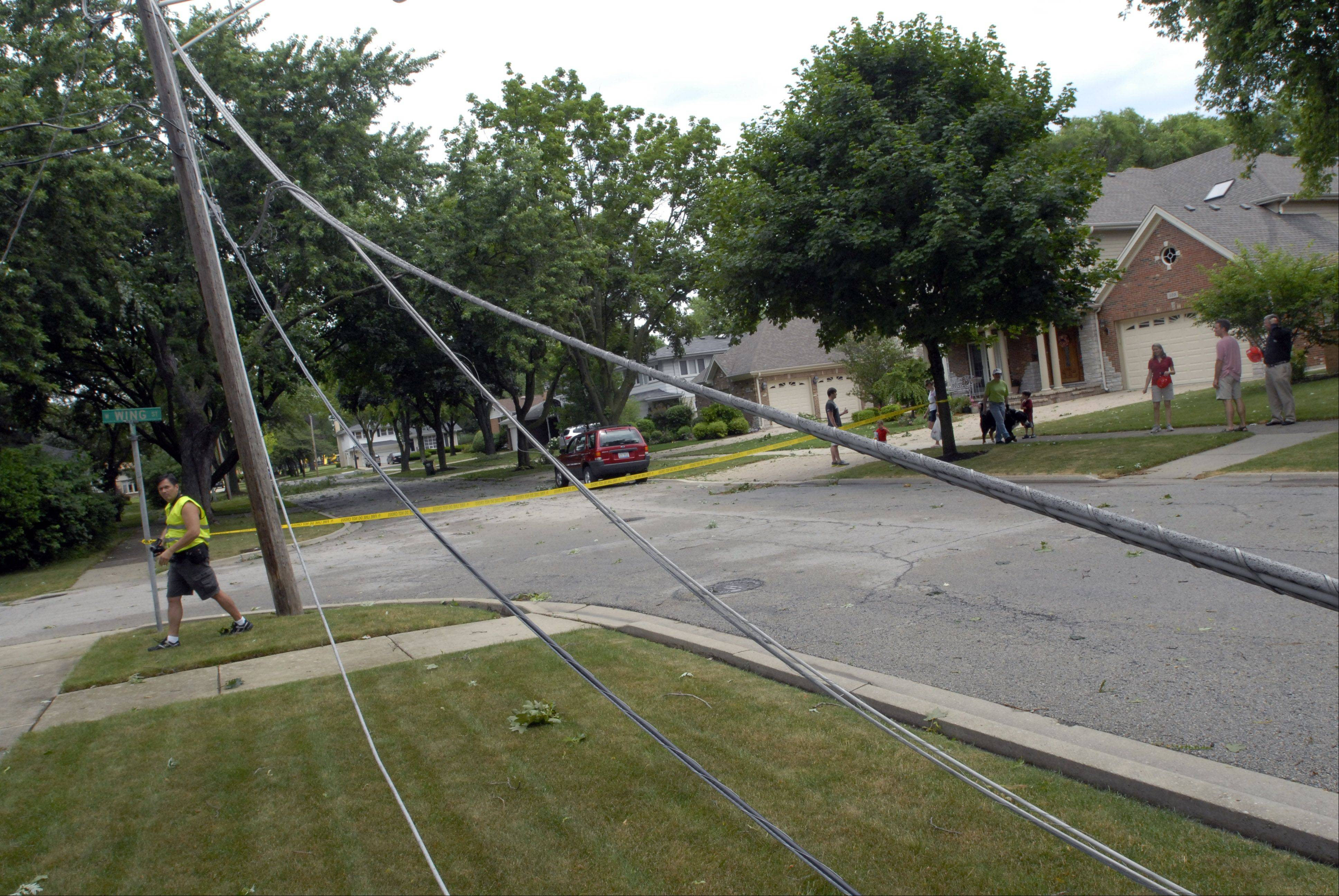 Wires are down on Kennicott Avenue at Wing Street after a thunderstorm capable of producing 70 mile per hour winds hit the area Monday morning in Arlington Heights.