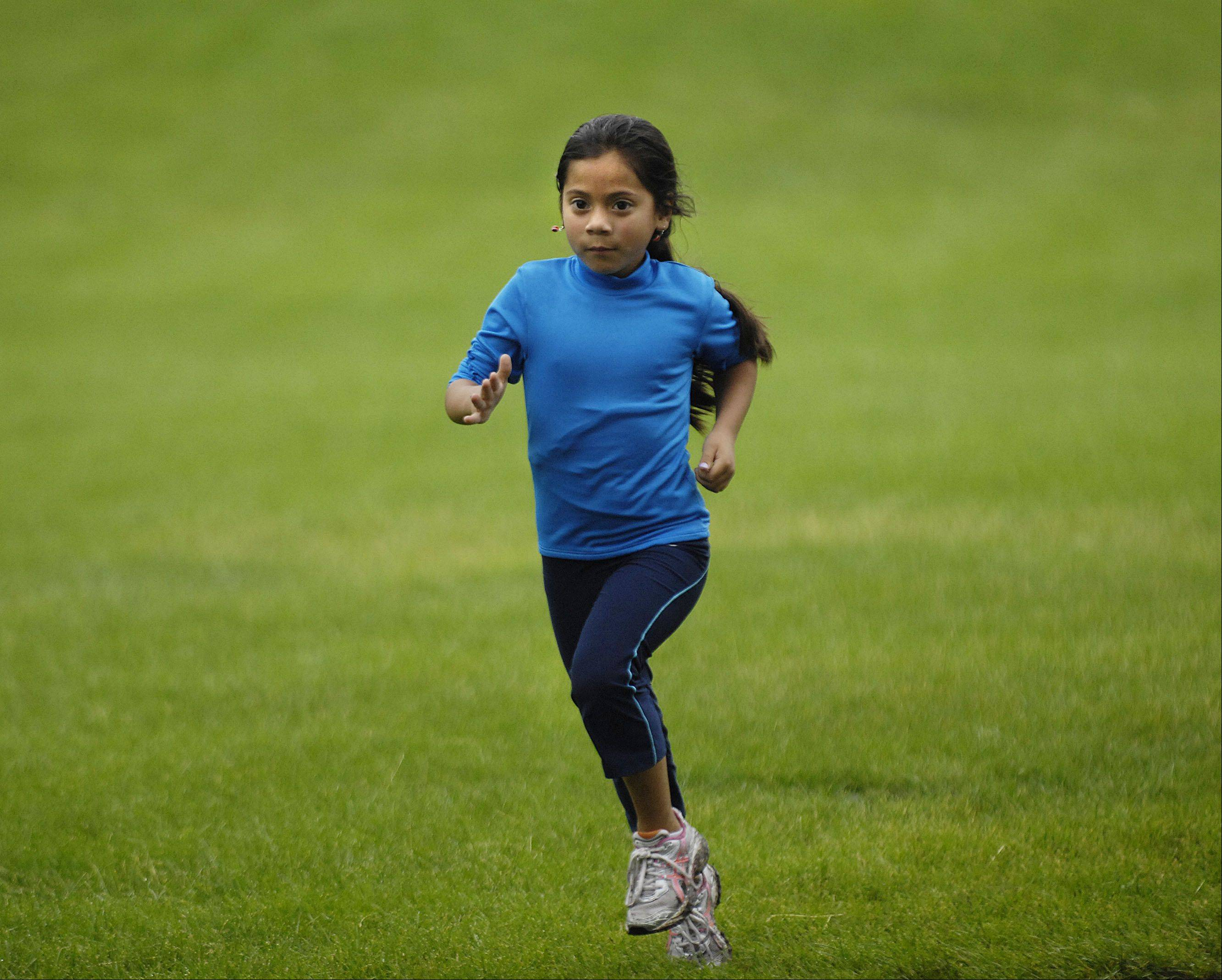 Dandrea Delgado, 7, runs up to three times weekly with the Elgin Sharks running club at Channing Park in Elgin.