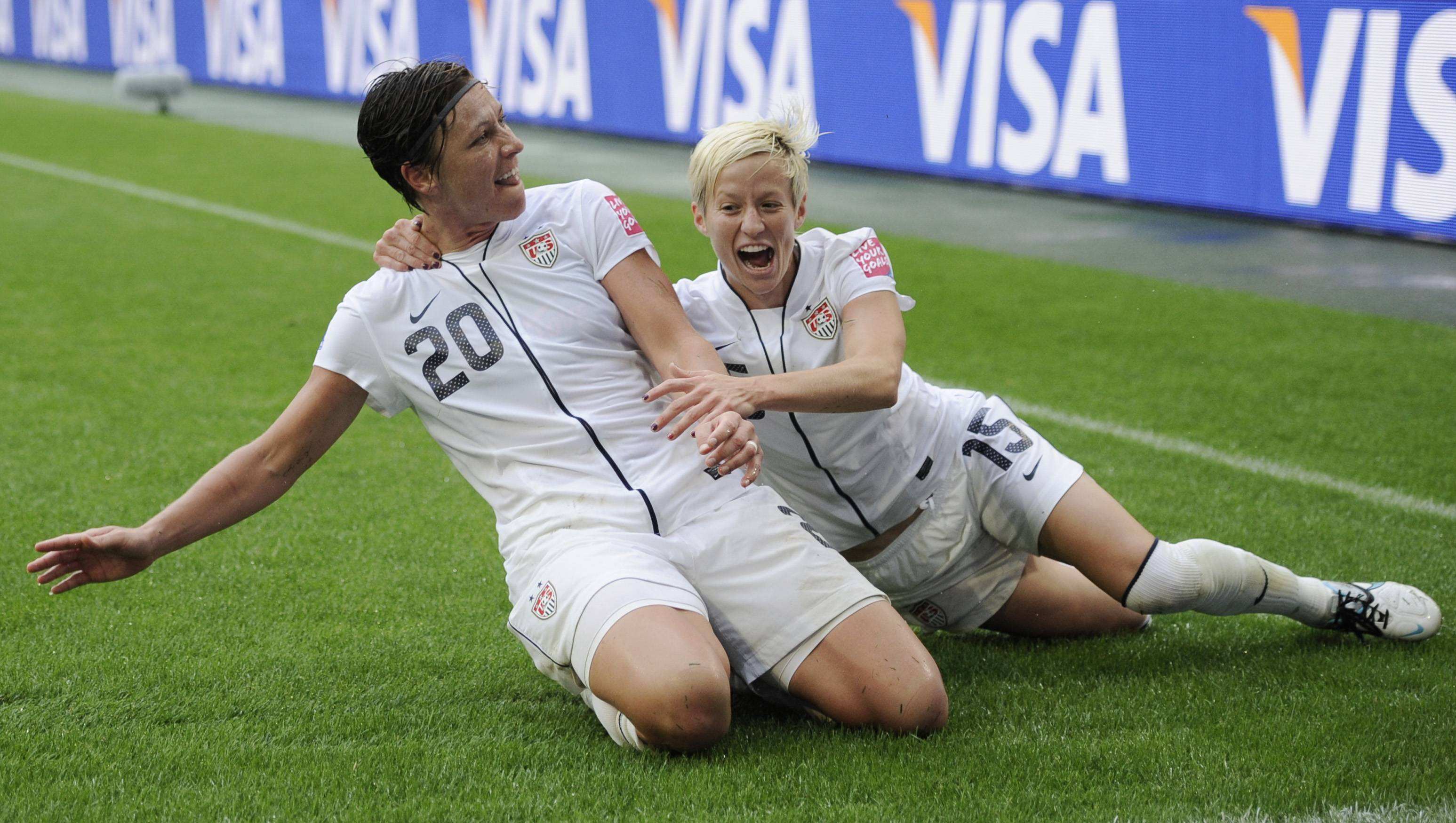 Abby Wambach celebrates with Megan Rapinoe after scoring her second goal Wednesday during the semifinal match between France and the United States at the Women's Soccer World Cup in Moenchengladbach, Germany.