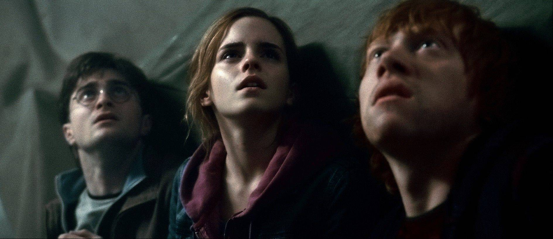"Harry (Daniel Radcliffe), left, leads his pals Hermione (Emma Watson) and Ron (Rupert Grint) through a perilous battleground during ""Harry Potter and the Deathly Hallows -- Part 2."""