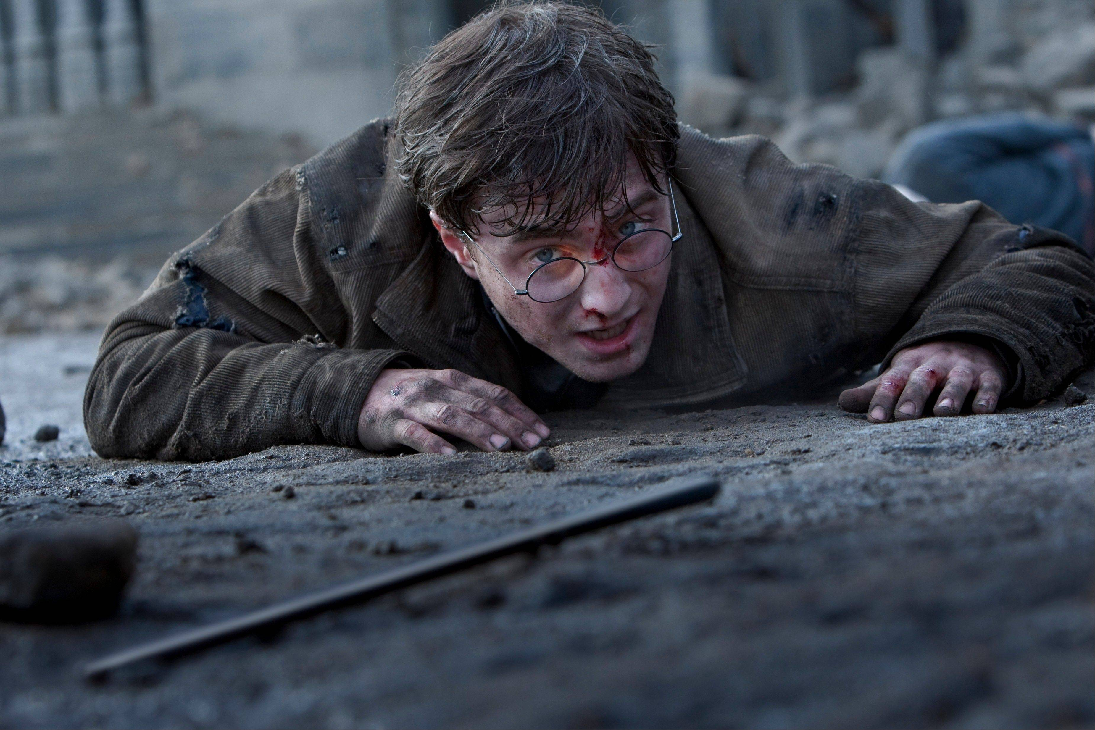 "Harry (Daniel Radcliffe) struggles to regain his wand in during a fight with the Dark Lord in ""Harry Potter and the Deathly Hallows -- Part 2."""