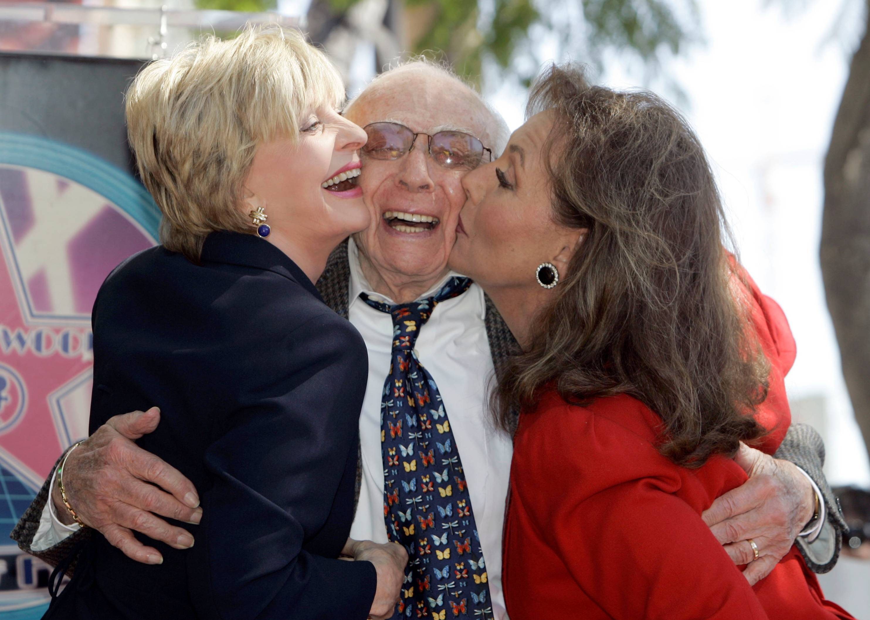 Writer/producer Sherwood Schwartz received a kiss from actresses Florence Henderson, left, and Dawn Wells during a ceremony where Schwartz was honored with a star on the Hollywood Walk of Fame in 2008. Schwartz died Tuesday at the age of 94.