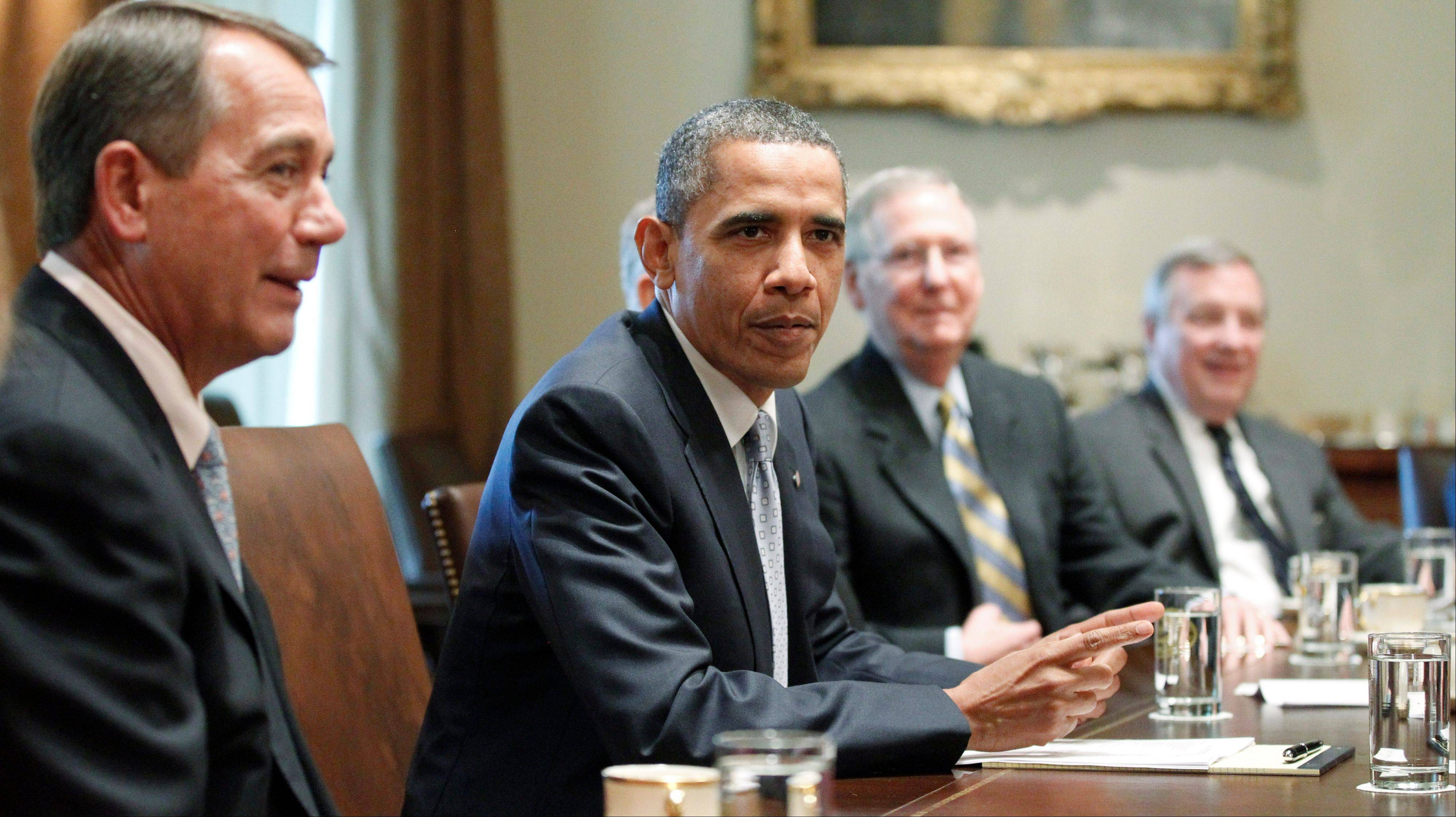 President Barack Obama sits with House Speaker John Boehner, Senate Minority Leader Mitch McConnell and Illinois Sen. Dick Durbin in Wednesday's debt reduction talks at the White House.