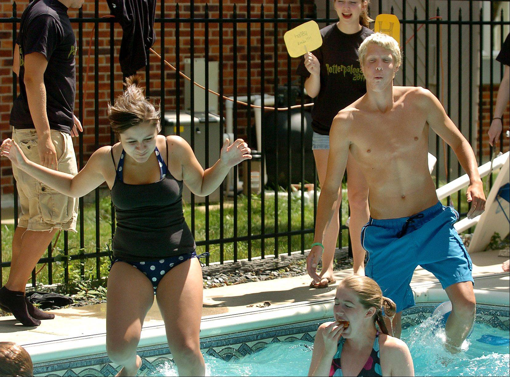 Triwizard champions from left, Asha Bazil, Haley Shoaf and Dustin Anderson jump in the pool after eating Gillyweed to complete the second task of finding items on the bottom.