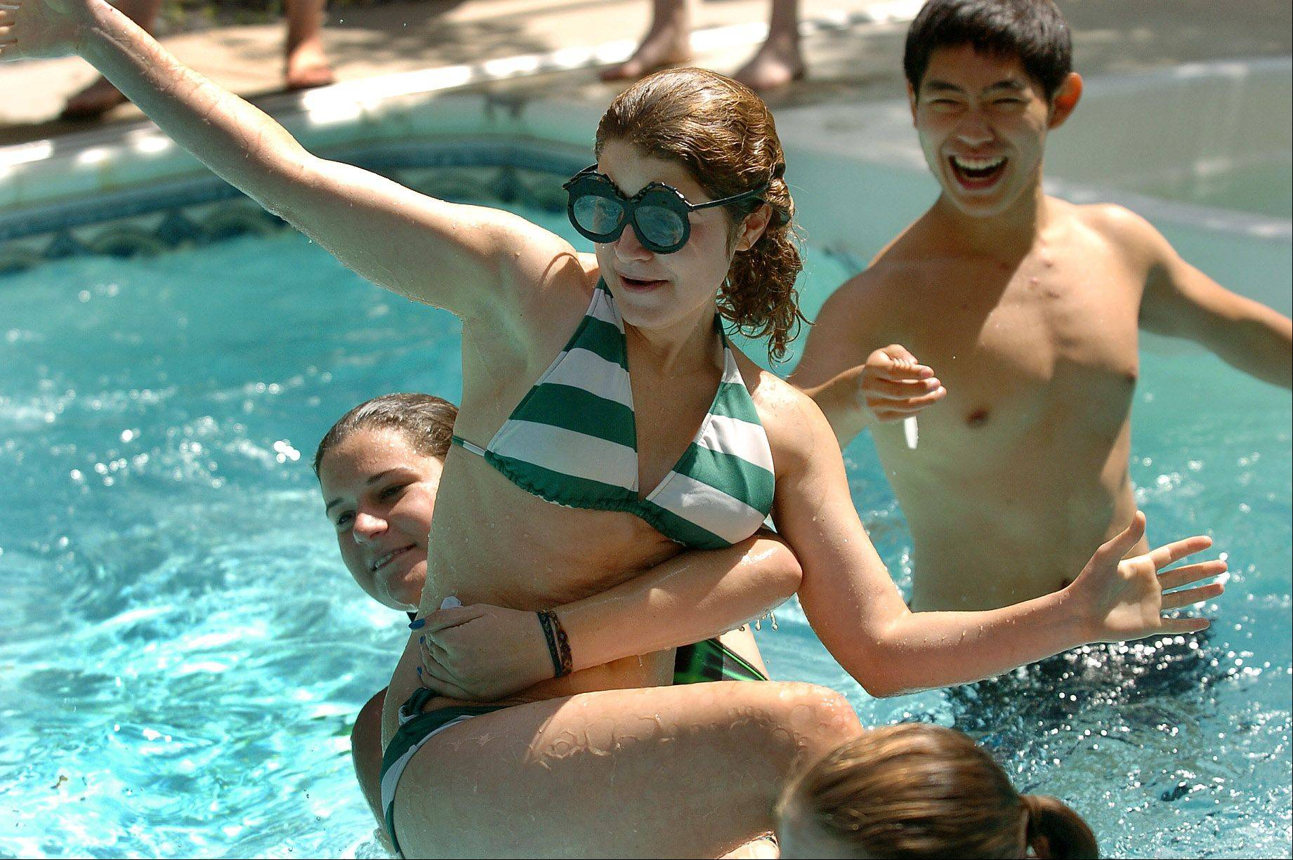 Jackie Gallo, a Triwizard champion, gets flung around in the pool while trying to retrieve items related to her second task, as Fremd High graduates band together to compete in a Harry Potter-based competition in celebration of the final film.
